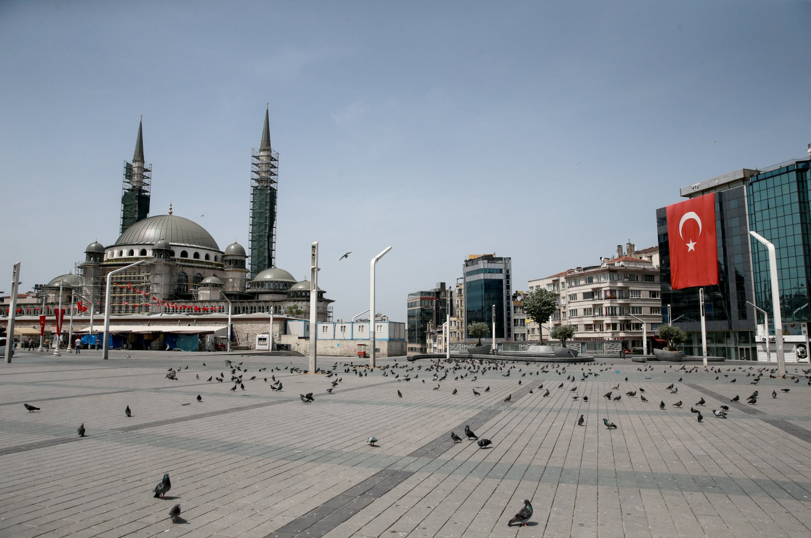 A view of Taksim Square, otherwise one of the busiest venues in Istanbul, on the third day of a coronavirus curfew, May 18, 2020. (AA Photo)