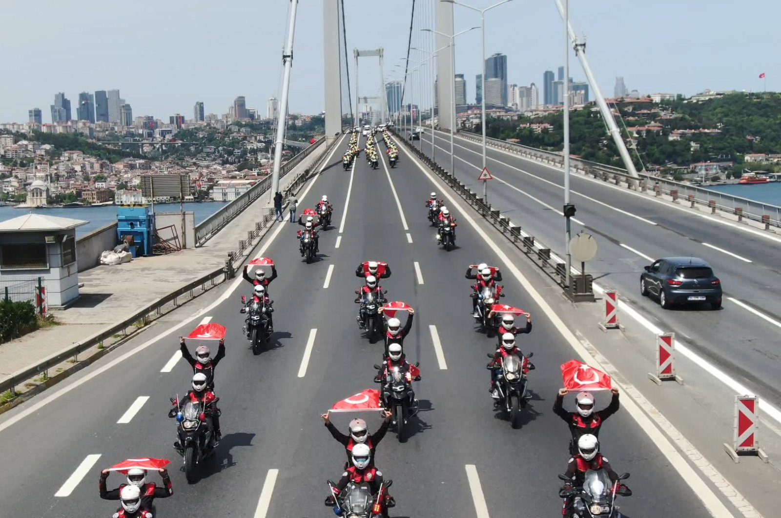 A Turkish police cortege takes place on the Bosporus Bridge, which is almost empty due to the four-day curfew imposed as part of the coronavirus struggle, Istanbul, Turkey, May 19, 2020. (DHA Photo)