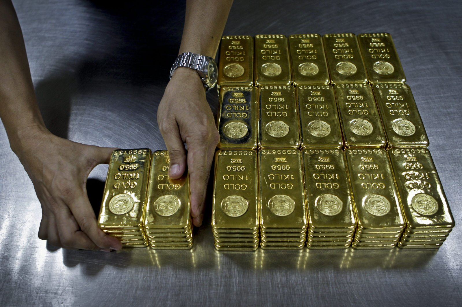 In this file photo a technician prepares 1 Kg gold bars of 995.0 purity to pack for delivery at the Emirates Gold company in Dubai, United Arab Emirates, Oct. 9, 2012. (AP Photo)