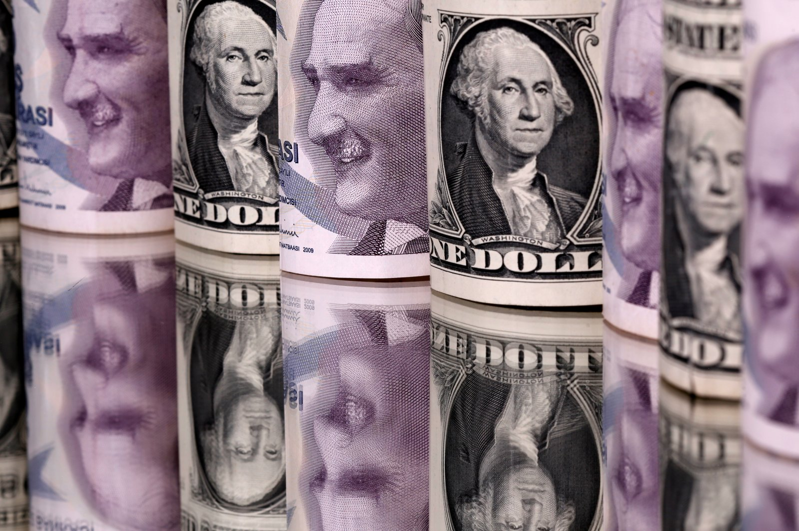 The Turkish lira and U.S. dollar banknotes are seen in this illustration taken Jan. 6, 2020. (Reuters Photo)