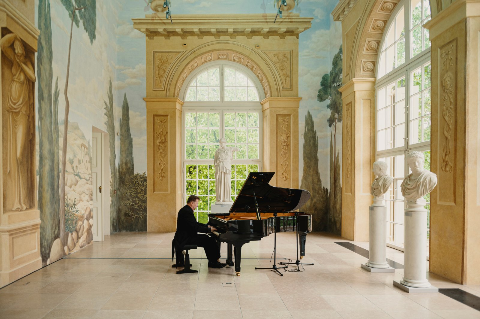 Pianist Karol Radziwonowicz plays Chopin's concert during a recording for online release, amid the outbreak of the coronavirus disease (COVID-19) in Warsaw, May 6, 2020. (Reuters Photo)