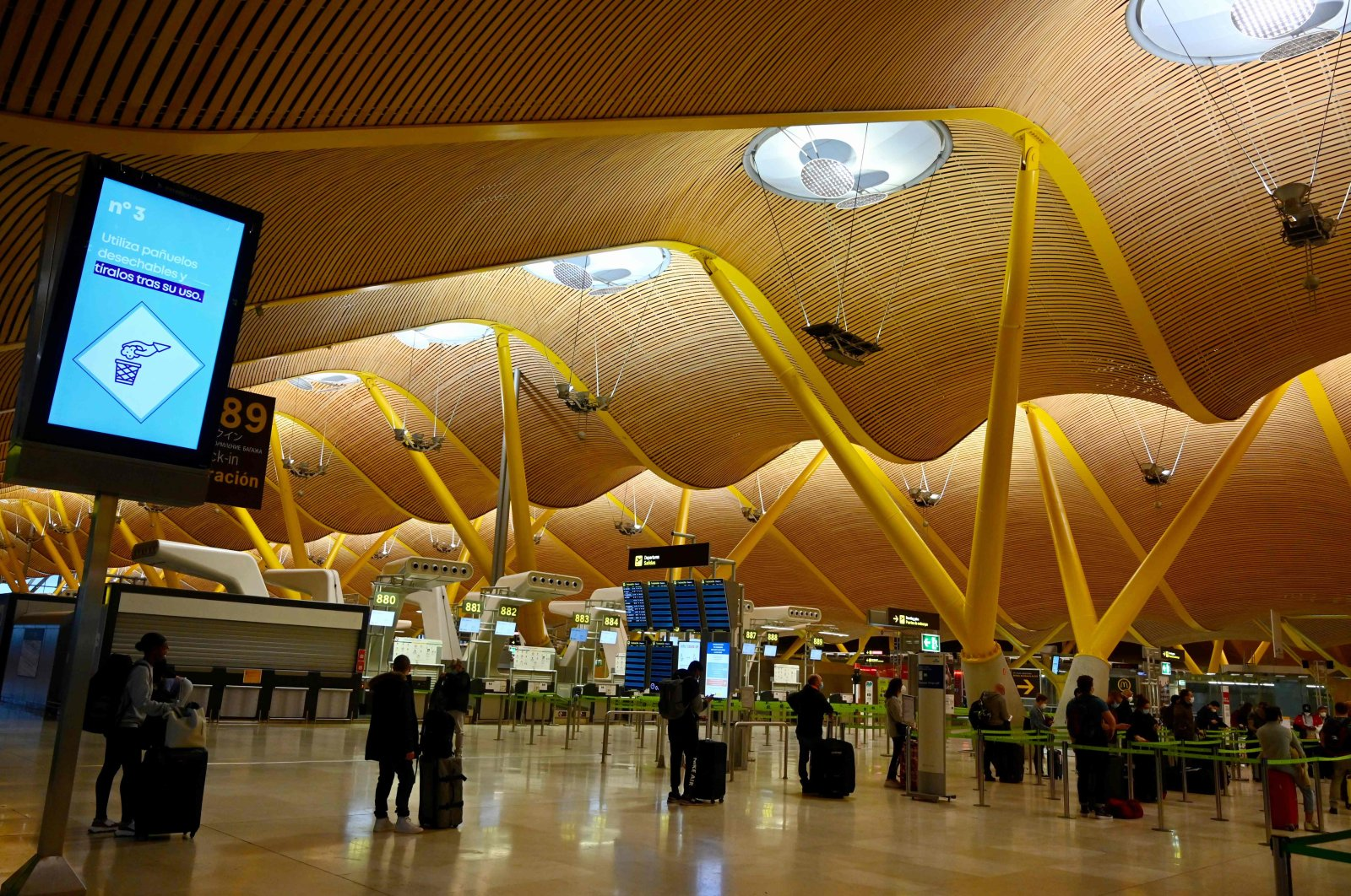 Passengers queue at the terminal 4 of the Madrid-Barajas Adolfo Suarez airport in Barajas on May 16, 2020. (AFP Photo)