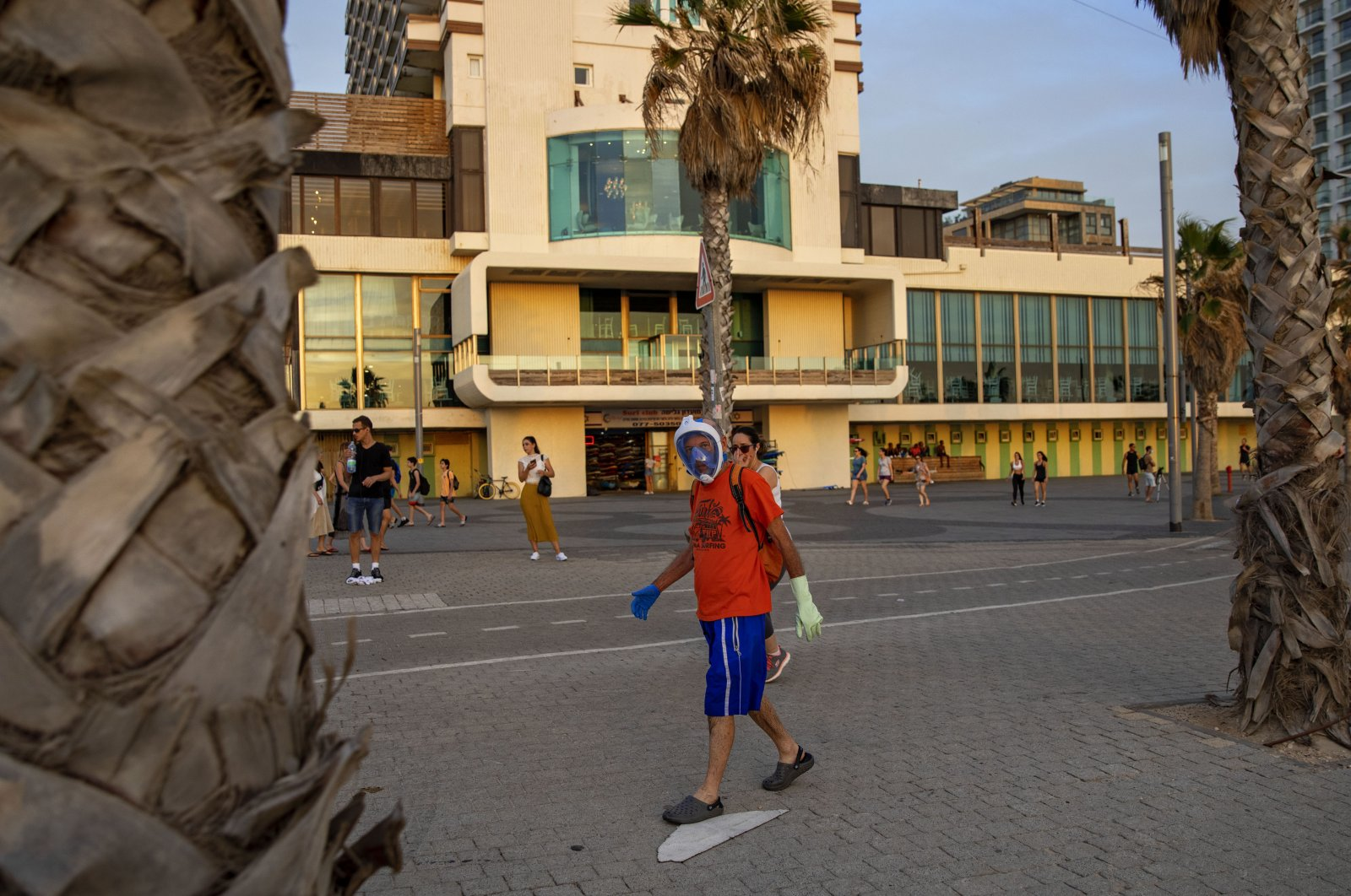 A man wears a diving mask as a protective face mask at the beachfront, Tel Aviv, Israel, May 16, 2020. (AP Photo)