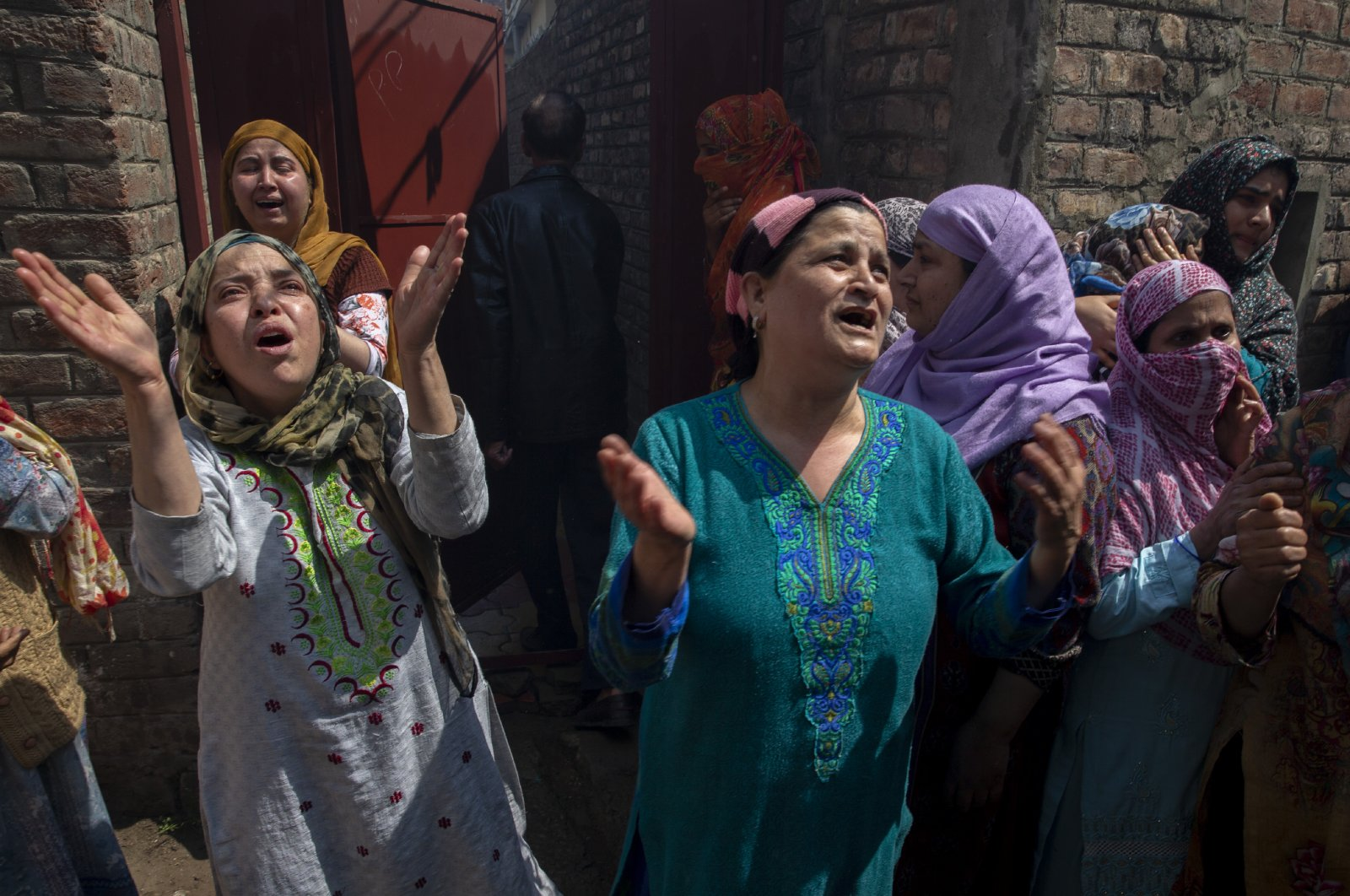 Kashmiri women grieve near the residential buildings damaged during a gun battle in Srinagar, Indian controlled Kashmir, May 19, 2020. (AP)