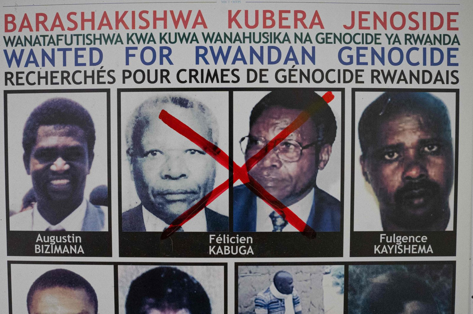 A red cross is seen drawn on the face of Felicien Kabuga, one of the last key suspects in the 1994 Rwandan genocide, on a wanted poster at the Genocide Fugitive Tracking Unit office in Kigali, Rwanda, May 19, 2020. (AFP)