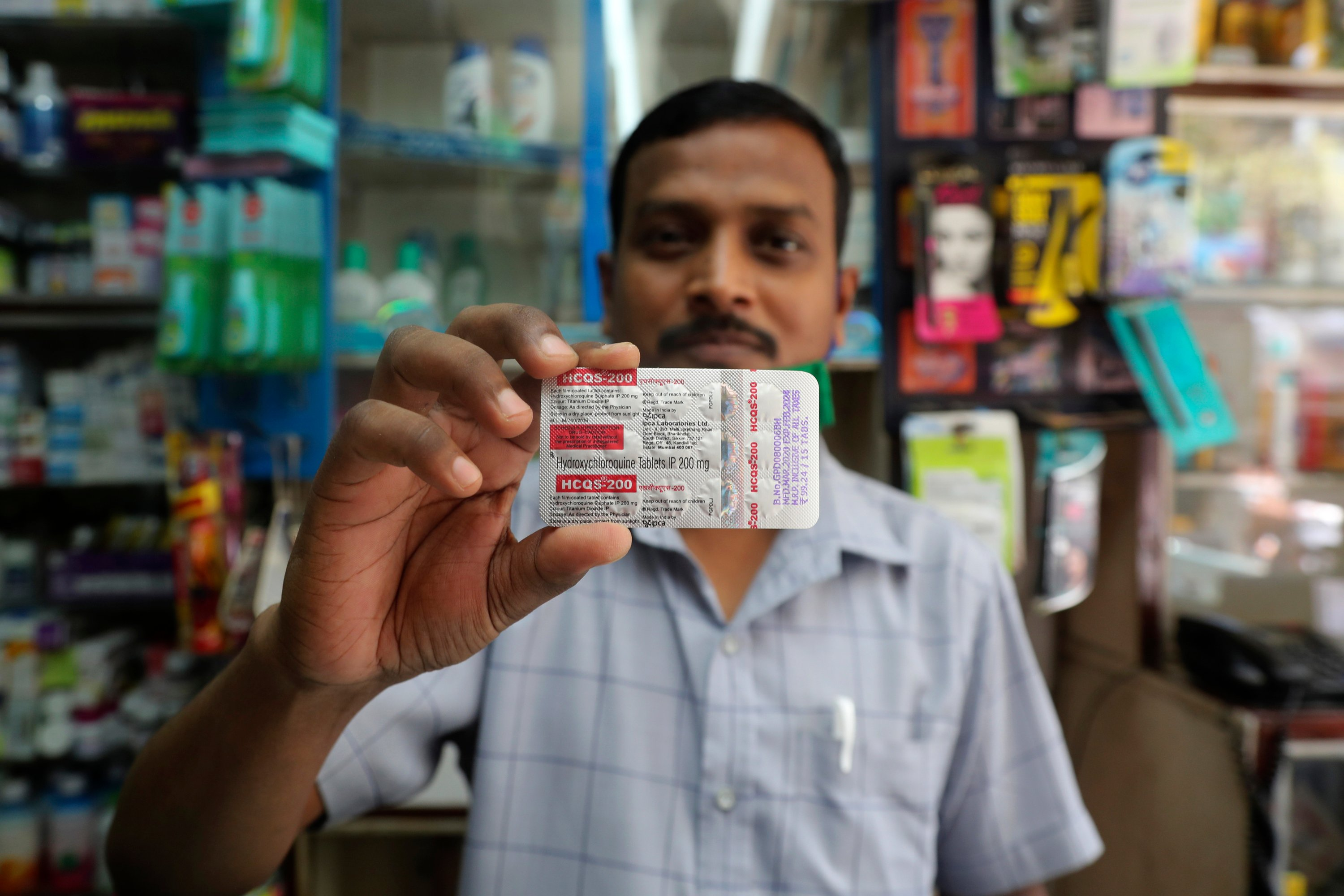 A chemist displays hydroxychloroquine tablets in Mumbai, India, Tuesday, May 19, 2020. (AP Photo)