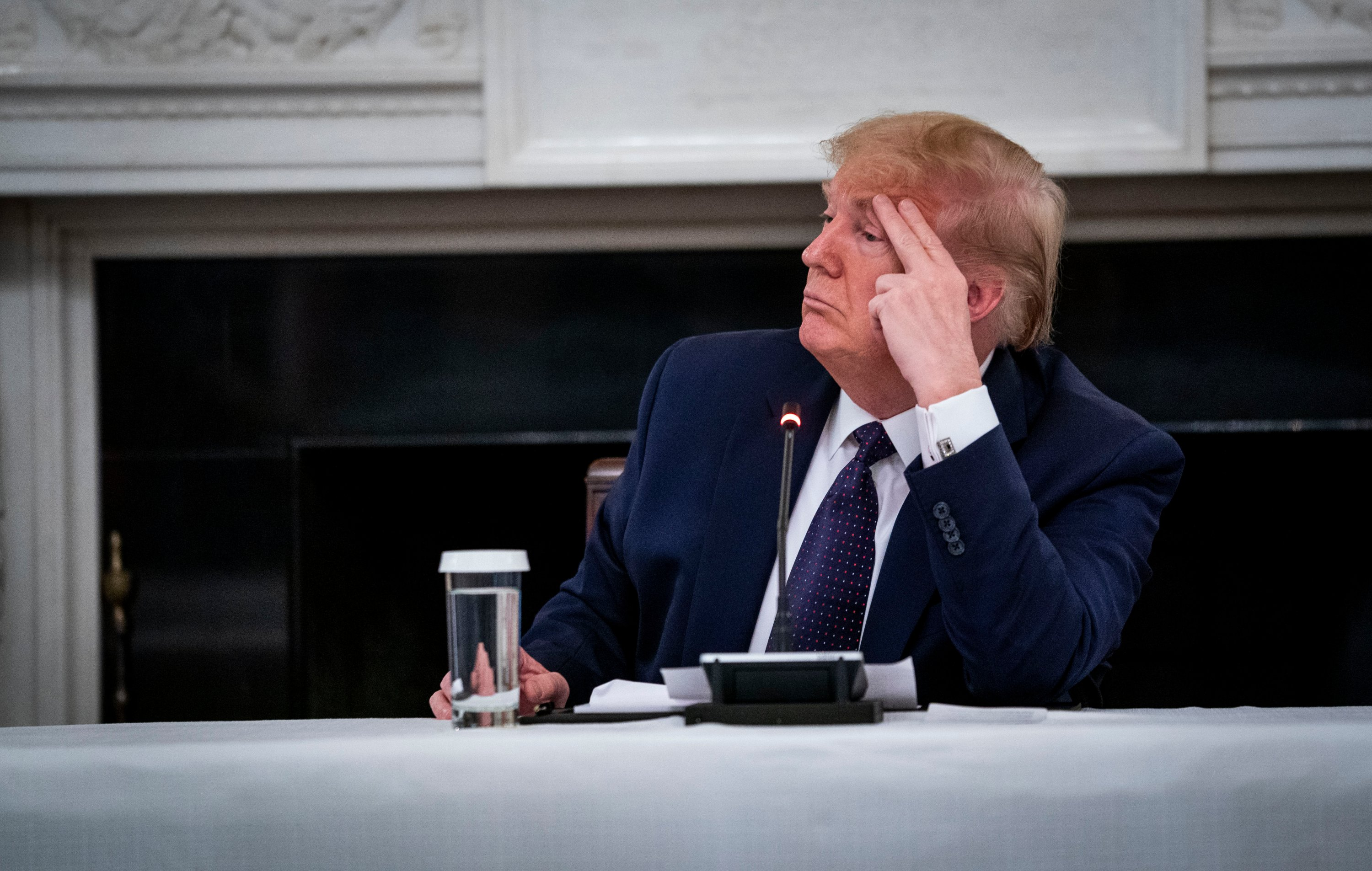 Donald Trump reveals that he is taking Hydroxychloroquine prophylaxis against COVID-19 as he participates in a roundtable with Restaurant Executives and Industry Leaders in the State Dining Room, Monday, May 18, 2020. (Reuters Photo)