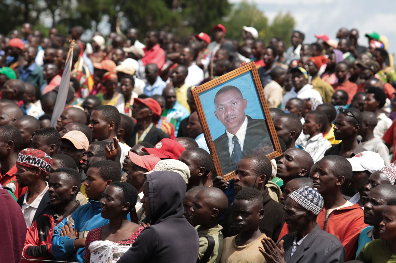 A supporter holds a picture of Agathon Rwasa, presidential candidate of the main opposition party the National Congress for Liberty (CNL), during the last day of the campaign in Gitega, central Burundi, May 17, 2020. (AFP Photo)