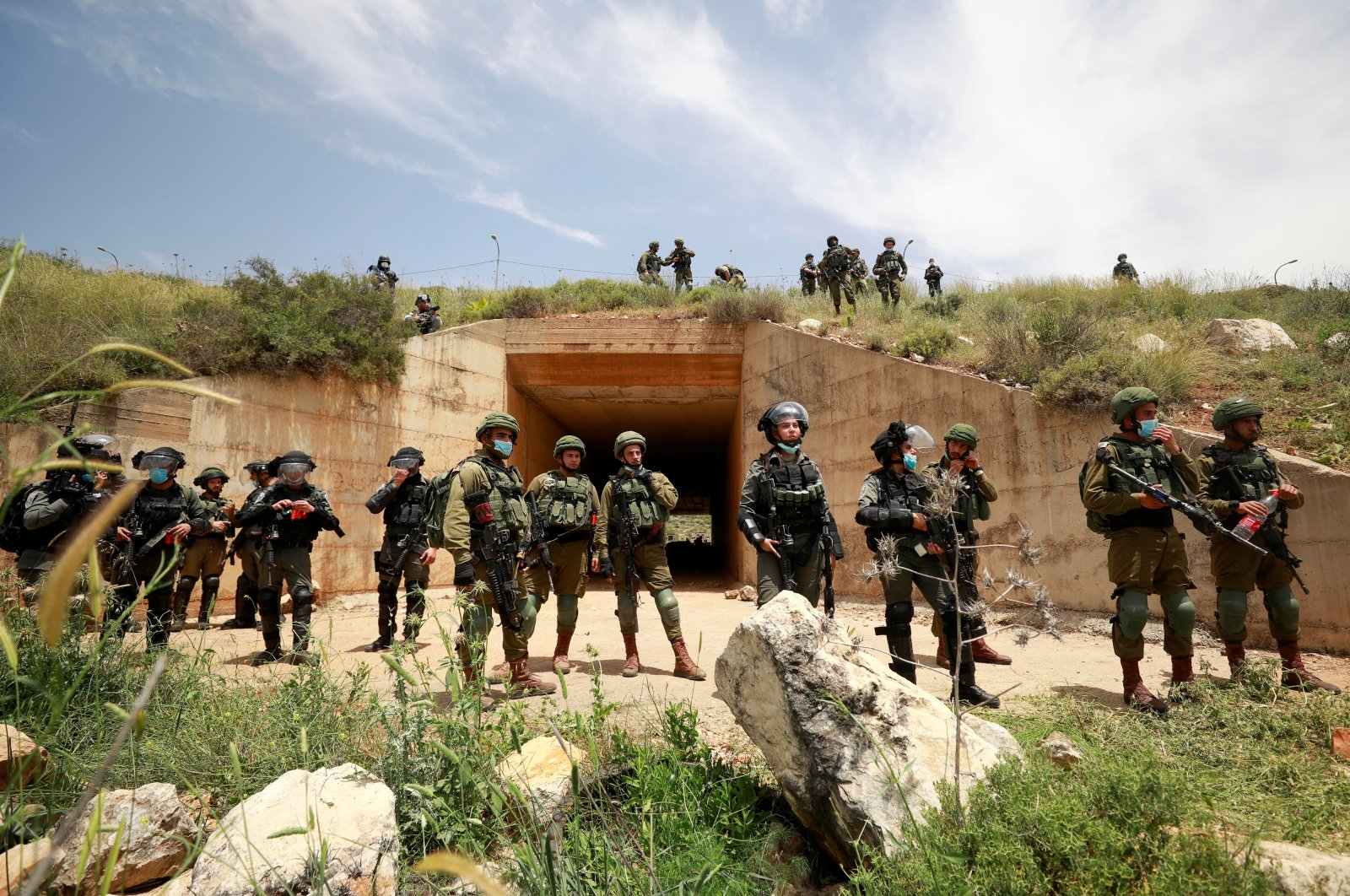 Israeli troops stand guard as Palestinians marking the 72nd anniversary of Nakba protest against Israel's plan to annex parts of the occupied West Bank, in the village of Sawiya near Nablus, May 15, 2020. (Reuters Photo)