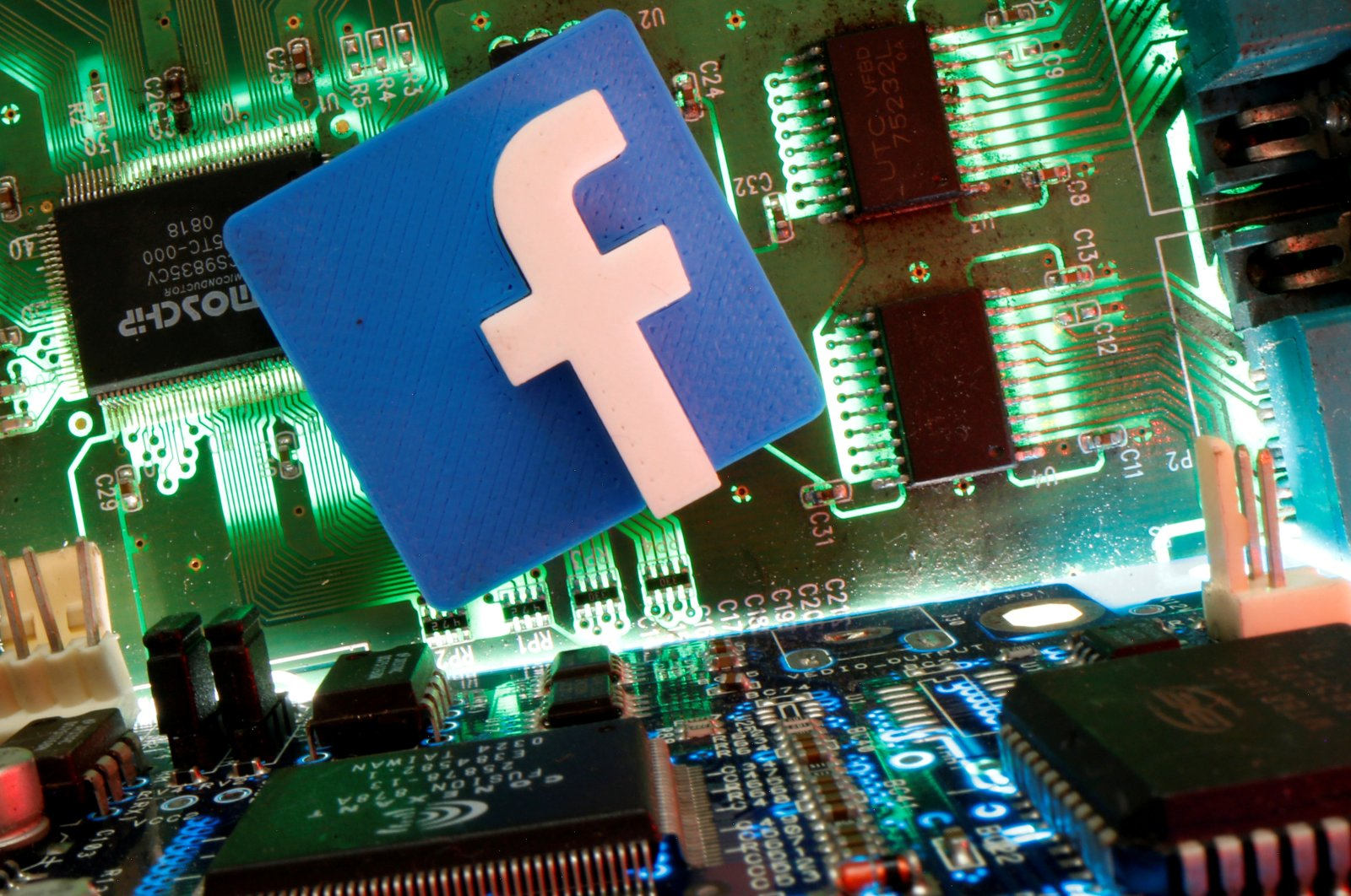 Facebook symbol is seen on a motherboard in this picture illustration taken April 24, 2020. (Reuters Photo)
