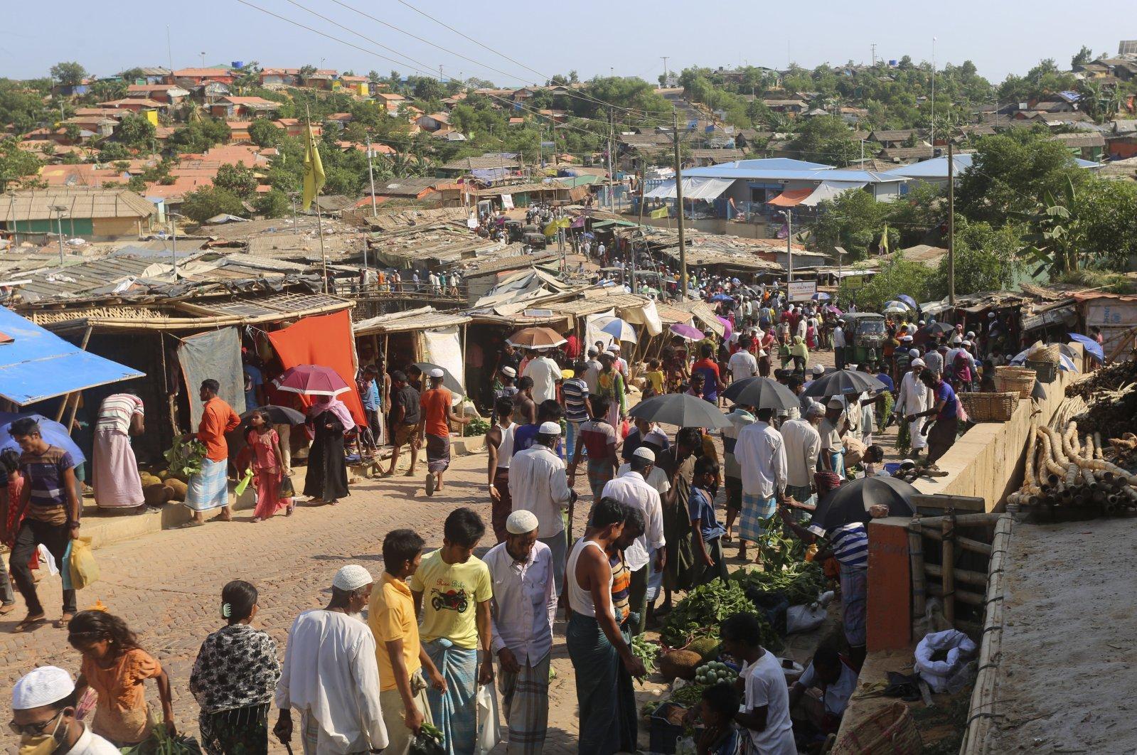 Rohingya refugees shop for vegetables at Kutupalong Rohingya camp bazaar, Cox's Bazar, Bangladesh, May 15, 2020. (AP Photo)