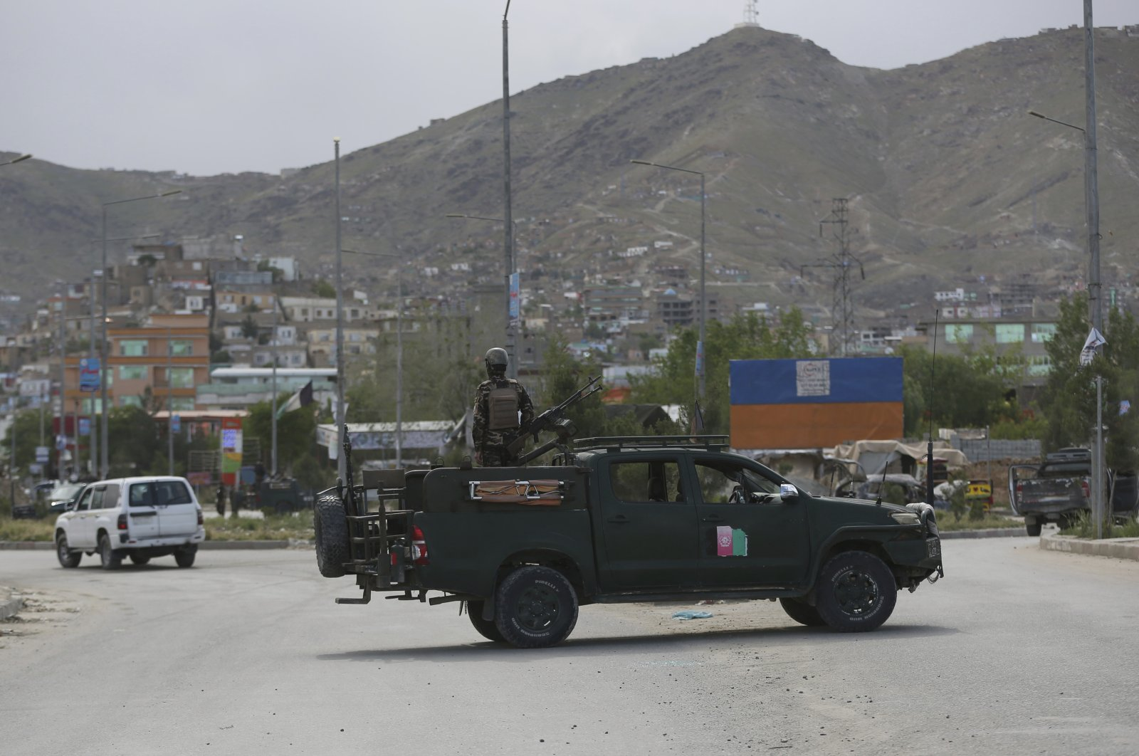Afghan security forces inspect the site of a bomb explosion in Kabul, Afghanistan, May 18, 2020. (AP Photo)