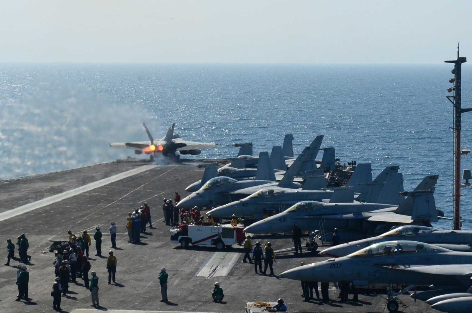In this image released by the US Navy launches off the flight deck of the aircraft carrier USS George H.W. Bush during flight operations in the Arabian Gulf, June 17, 2014. (AFP Photo)