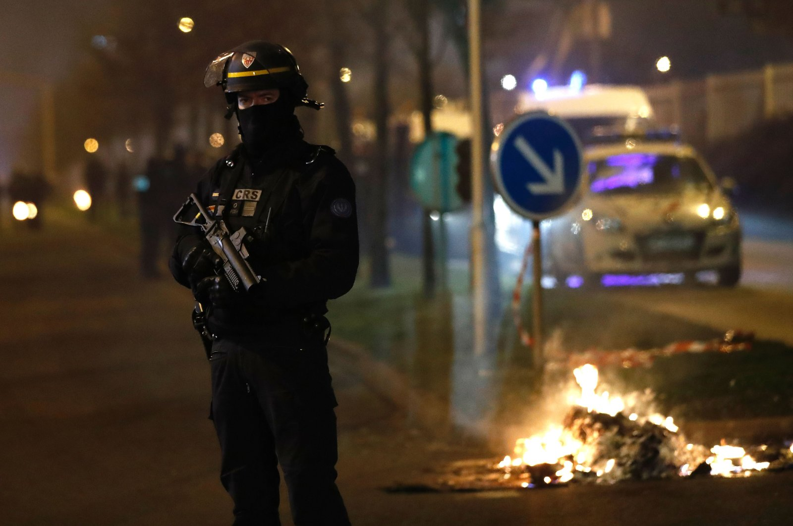 A French riot police officer secures the area during a protest in Bobigny, a district of northeast Paris, Feb. 11, 2017. (AFP Photo)