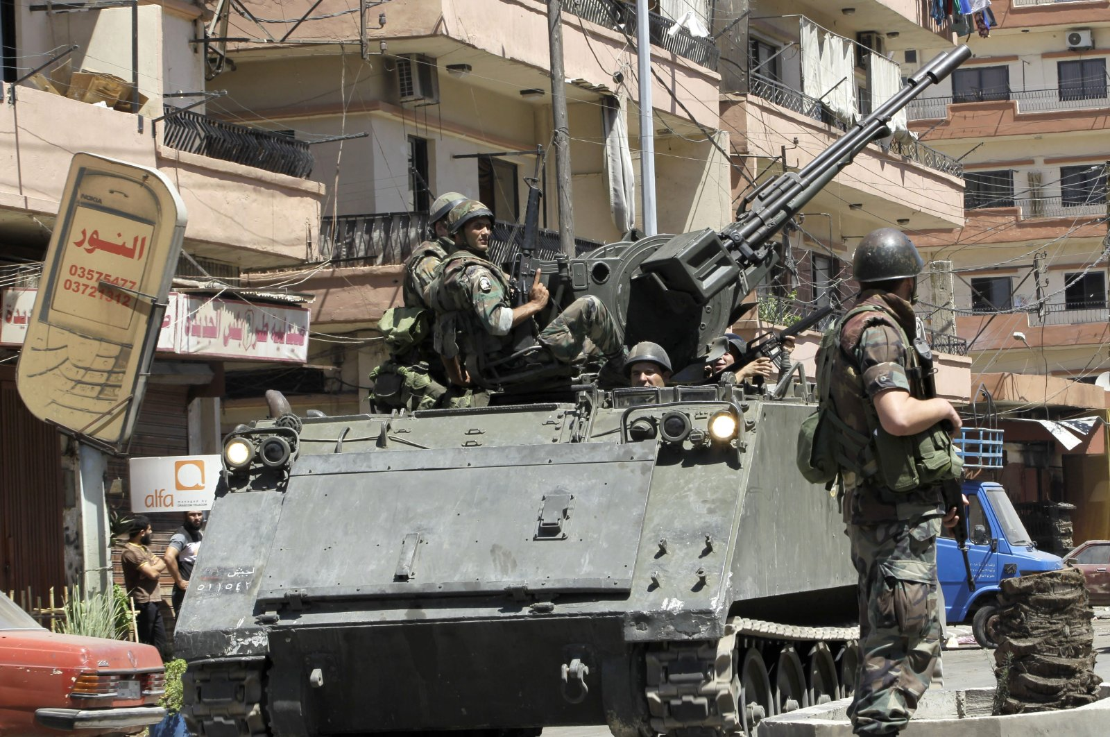 Lebanese army soldiers patrol after days of clashes between pro and anti-Syrian regime groups, in the northern city of Tripoli, Lebanon, Aug. 23, 2012. (AP Photo)