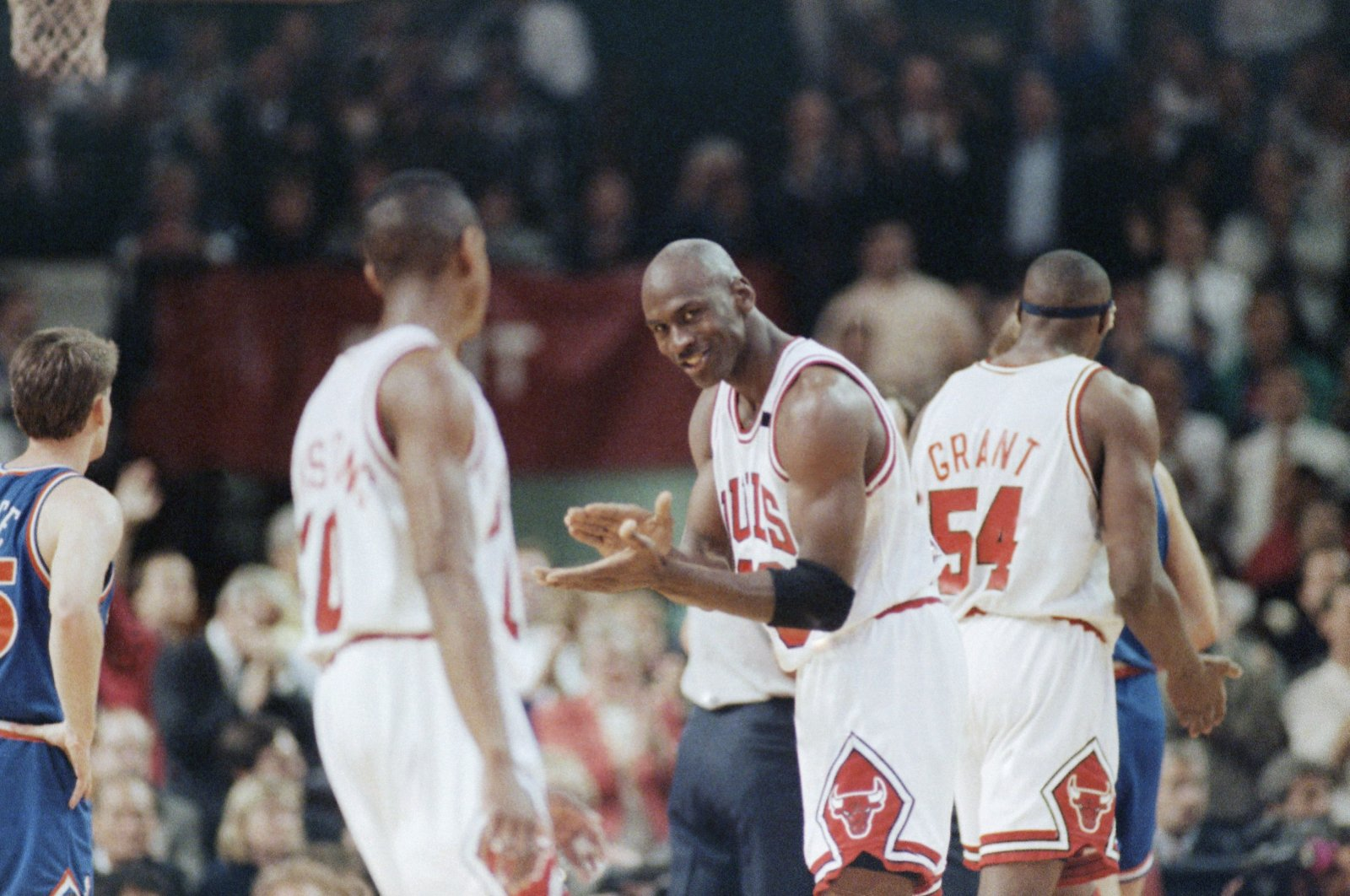 Michael Jordan (23) laughs, with teammate Horace Grant (54) in the background, during an NBA match in Chicago, Illinois, U.S., May 28, 1992. (AP Photo)