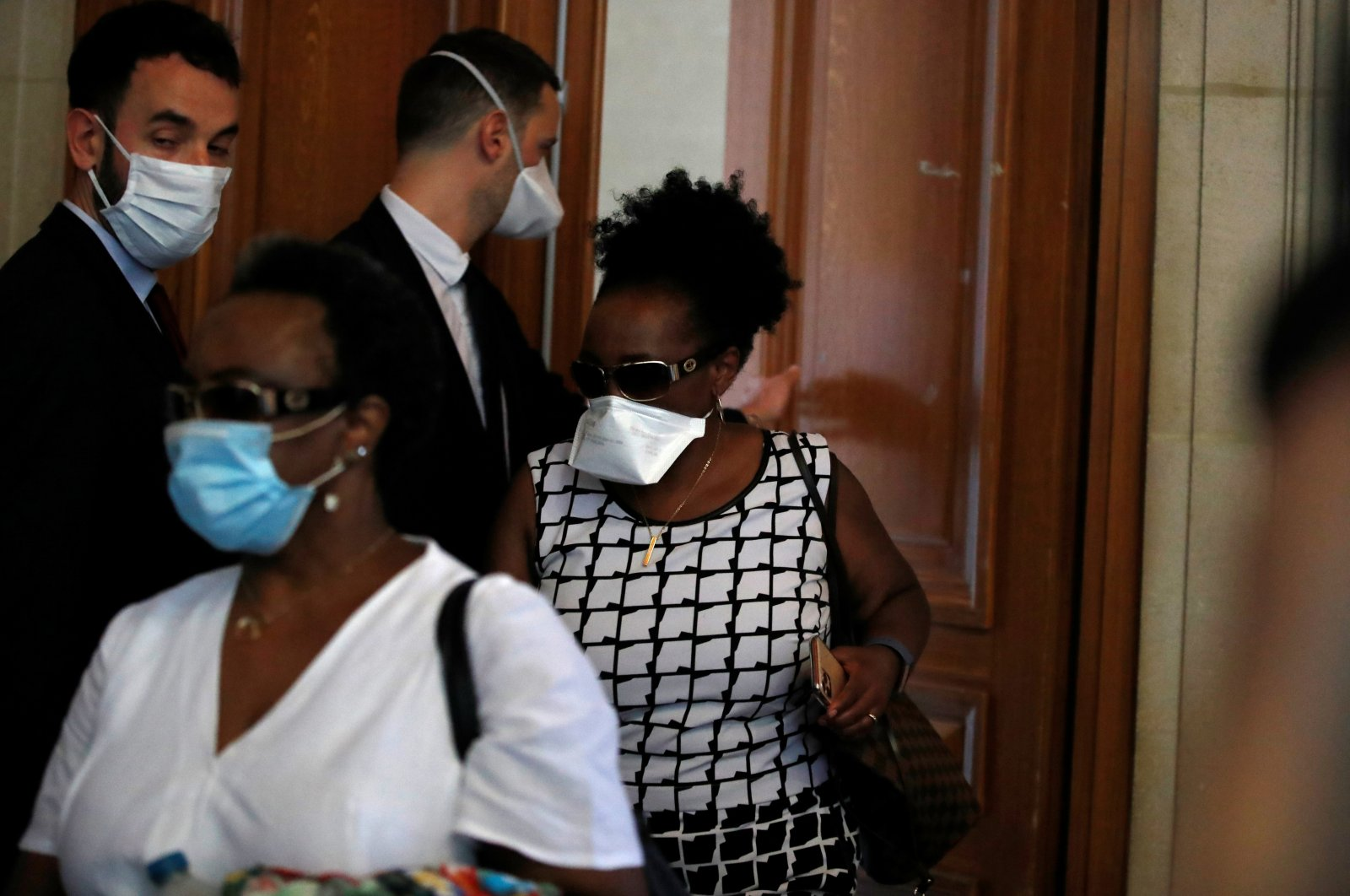 Relatives of Rwandan genocide suspect Felicien Kabuga arrive at the Paris courthouse before the initial extradition hearing for Felicien Kabuga in Paris, France, May 20, 2020. (Reuters Photo)