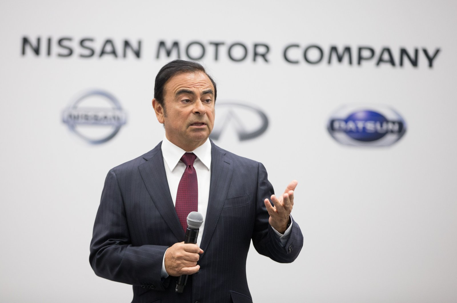 Carlos Ghosn, former chairman, president and chief executive officer of Nissan Motor Company, speaks to reporters during a press conference at the 2016 North American International Auto Show in Detroit, Michigan, Jan. 11, 2016. (AFP Photo)