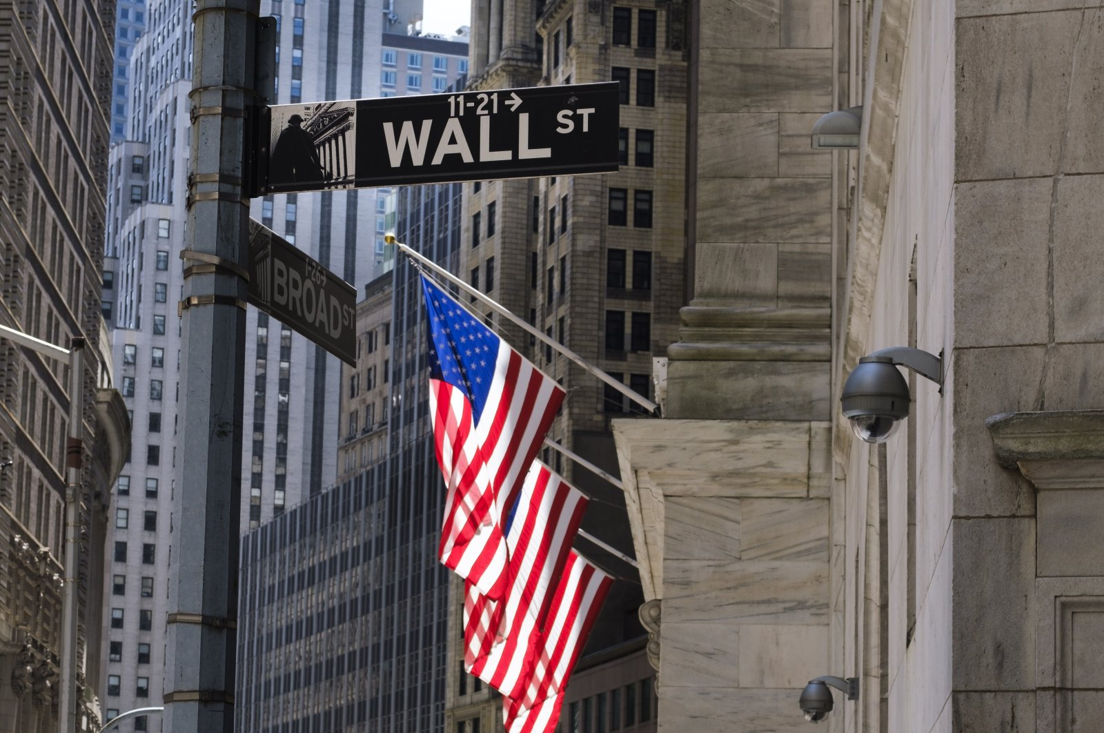 A view of a sign for Wall Street and the New York Stock Exchange in New York, New York, USA, 20 May 2020. The New York Exchange is set to reopen its trading floor next week after being closed since March due to the coronavirus pandemic. (EPA Photo)