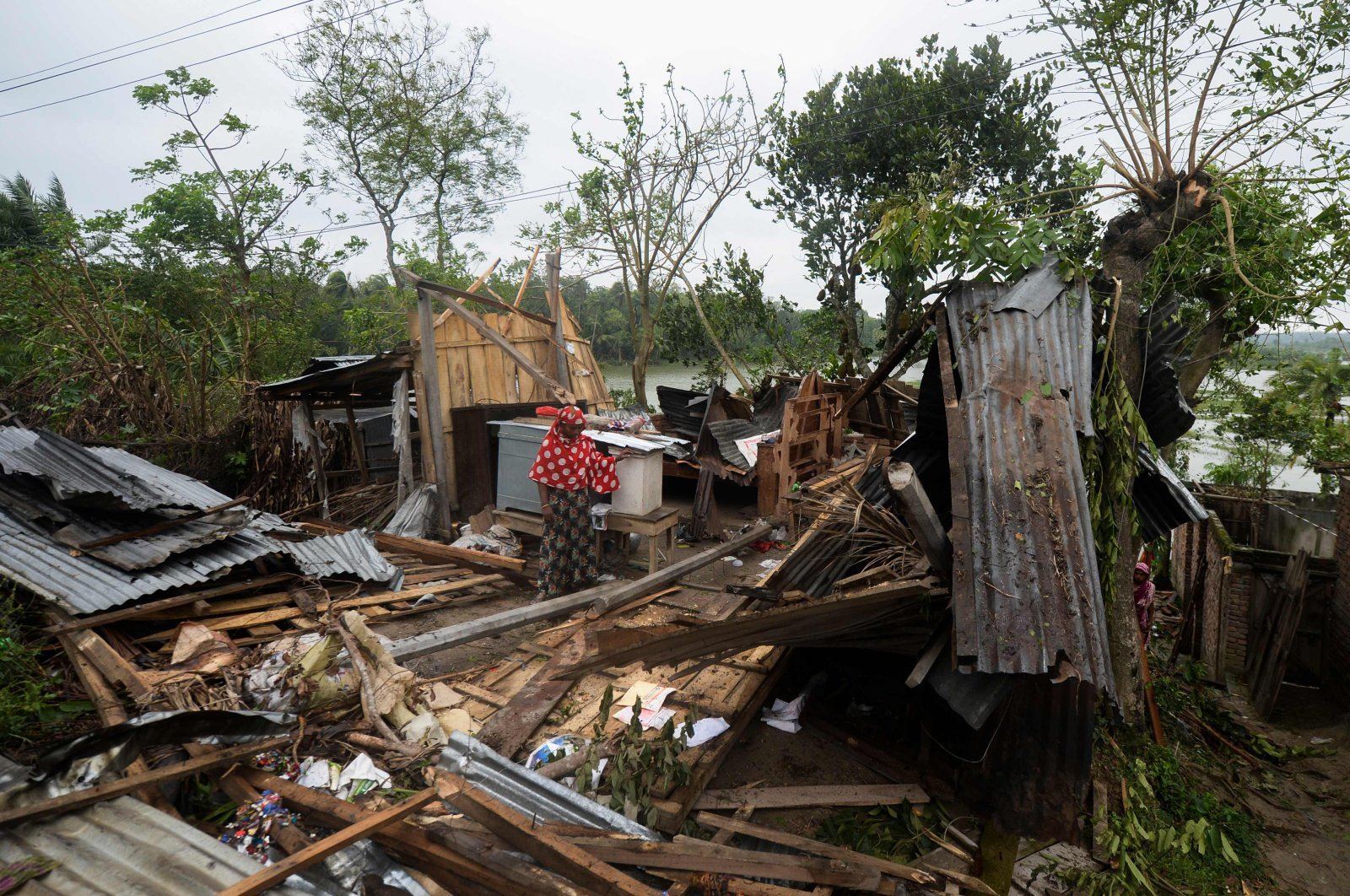 A woman stands amidst the debris of her house damaged by Cyclone Amphan in Satkhira, Bangladesh, May 21, 2020. (AFP Photo)