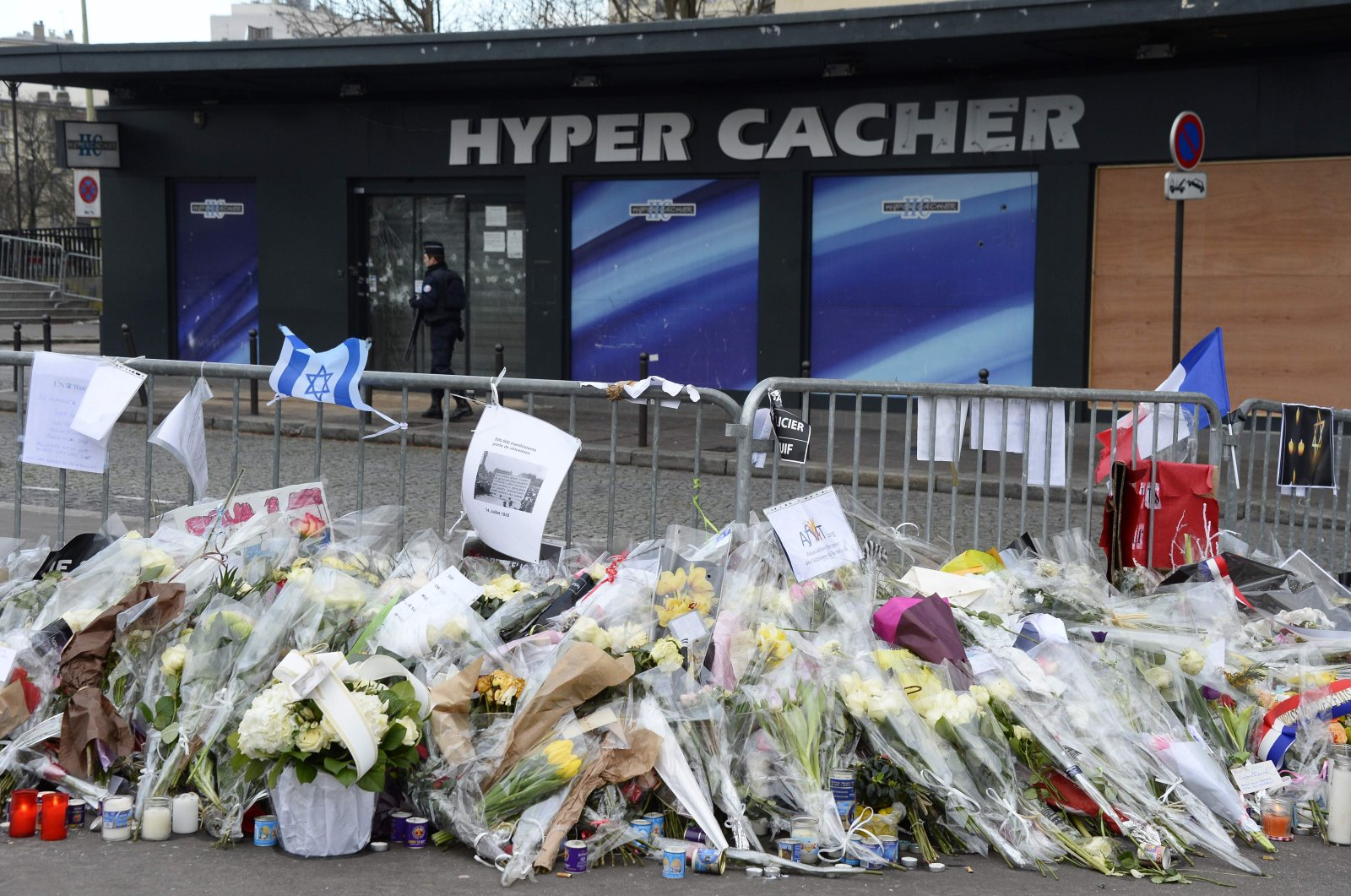 In this file photo taken on Jan. 16, 2015 shows flowers placed in tribute to the victims of the attack by Amedy Coulibaly at a supermarket in eastern Paris, France. (AFP Photo)