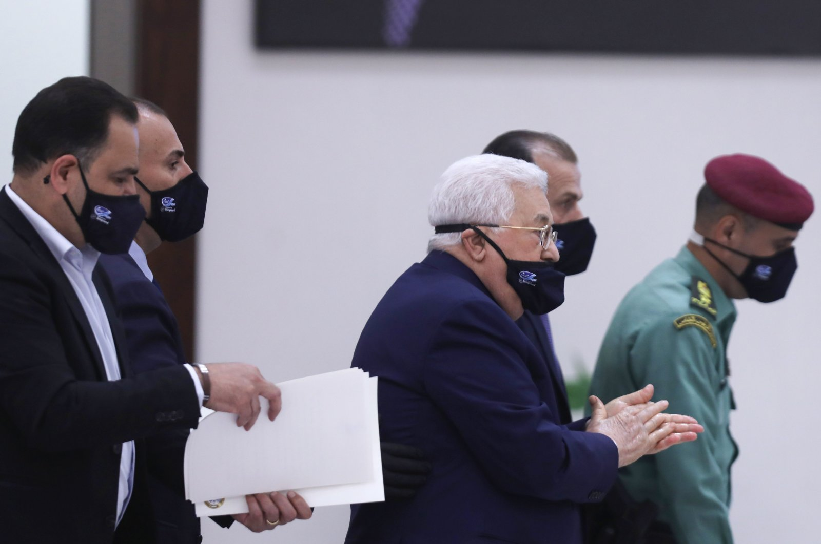 Palestinian President Mahmoud Abbas (C) leaves while wearing a protective mask due to the COVID-19 pandemic following the Palestinian leadership meeting at his headquarters in the West Bank city of Ramallah, Palestine, May 19, 2020. (AFP Photo)