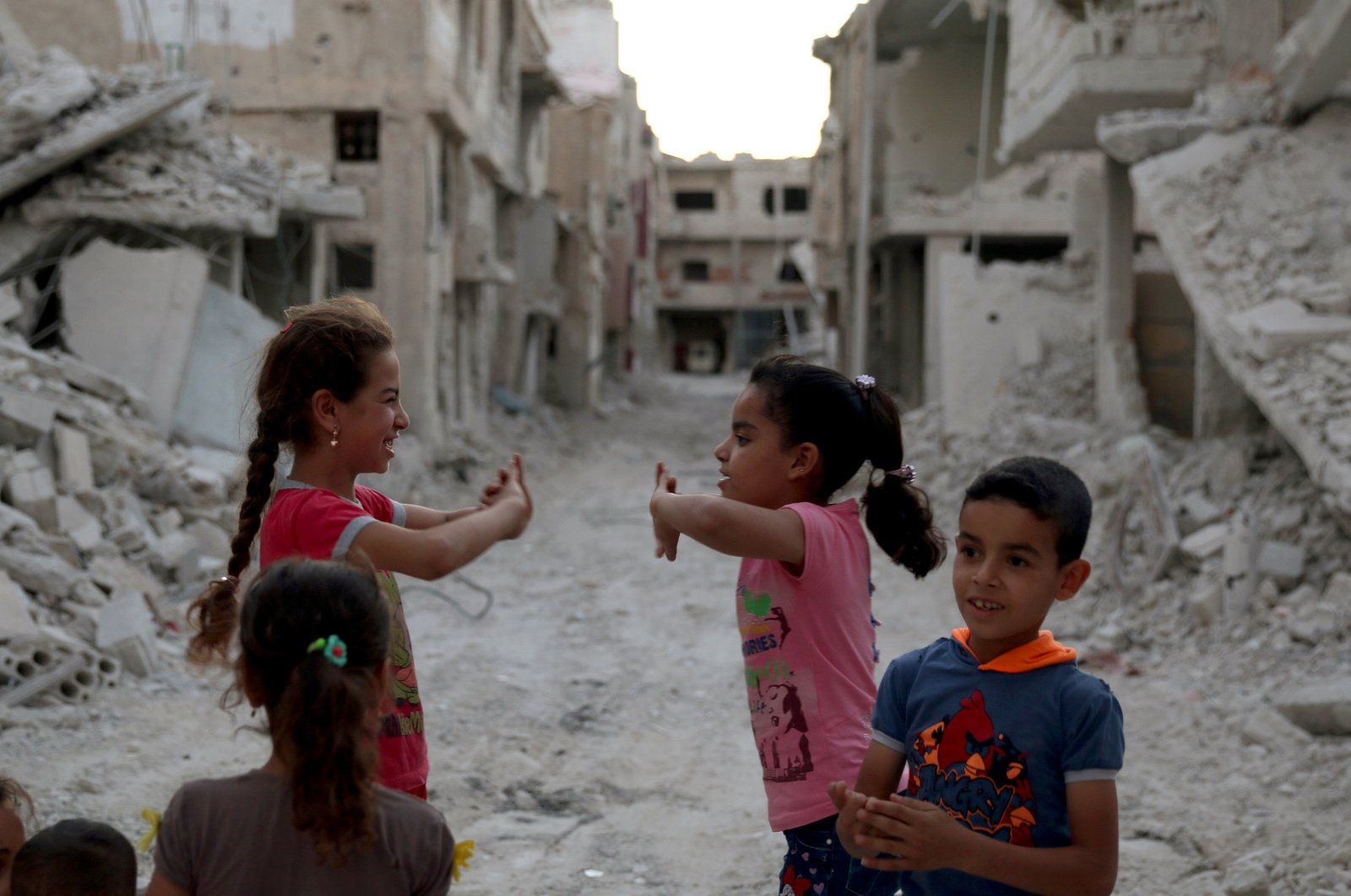 Syrian children are seen play amidst the rubble of damaged buildings in Deraa, July 15, 2017. (Reuters)