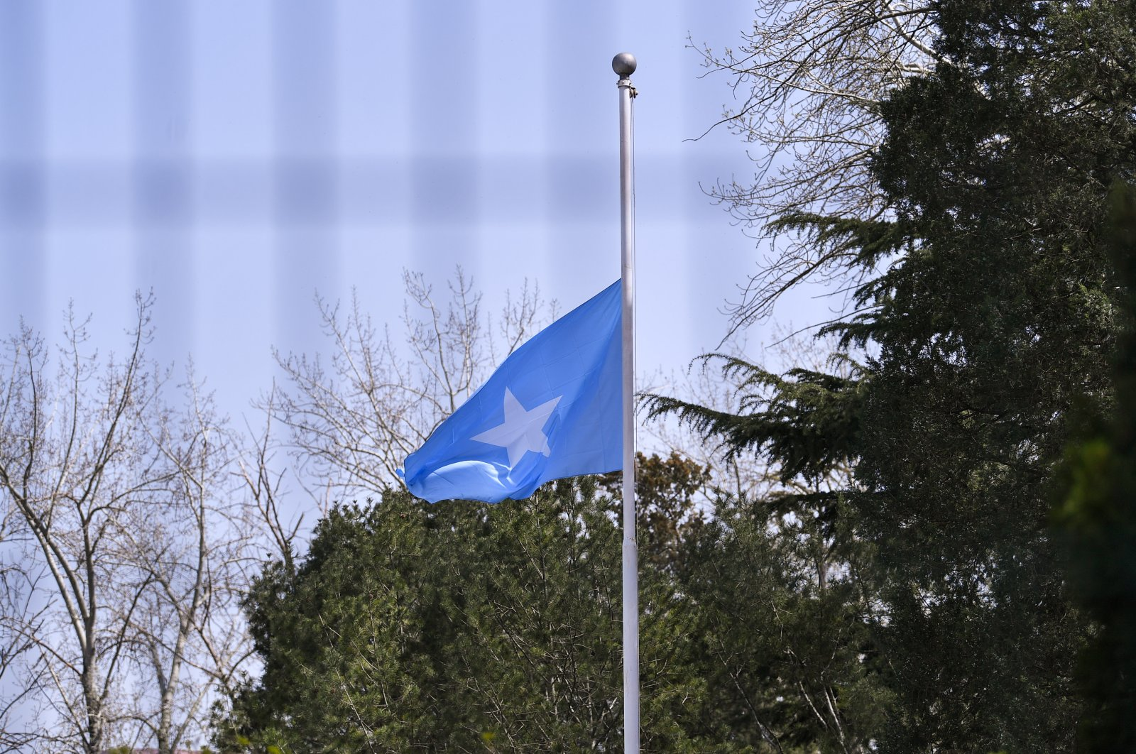 A Somalia flag is lowered to half mast to mourn for the martyrs who died in the fight of COVID-19 in the Somalia embassy in Beijing, China, April 4, 2020. (Reuters Photo)