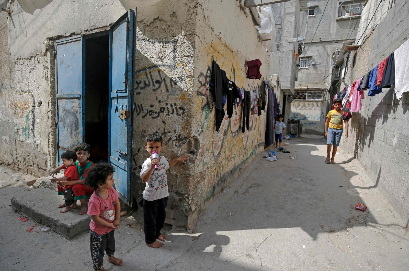 Palestinian children outside their shacks in Gaza City's al-Shati refugee camp, May 15, 2020. (AFP Photo)