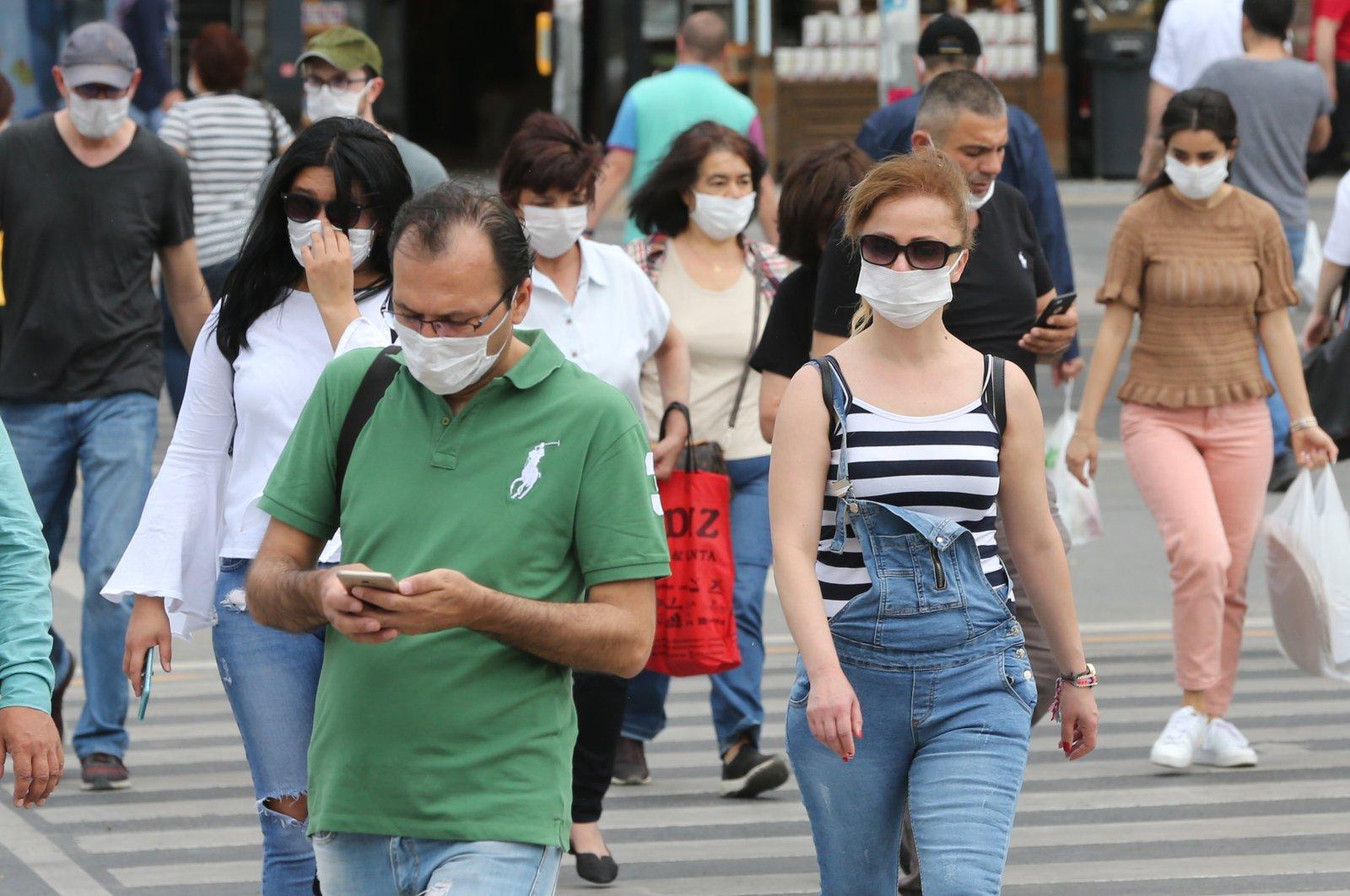 People walk on the streets of Turkey's capital Ankara, May 21, 2020 (AA Photo)