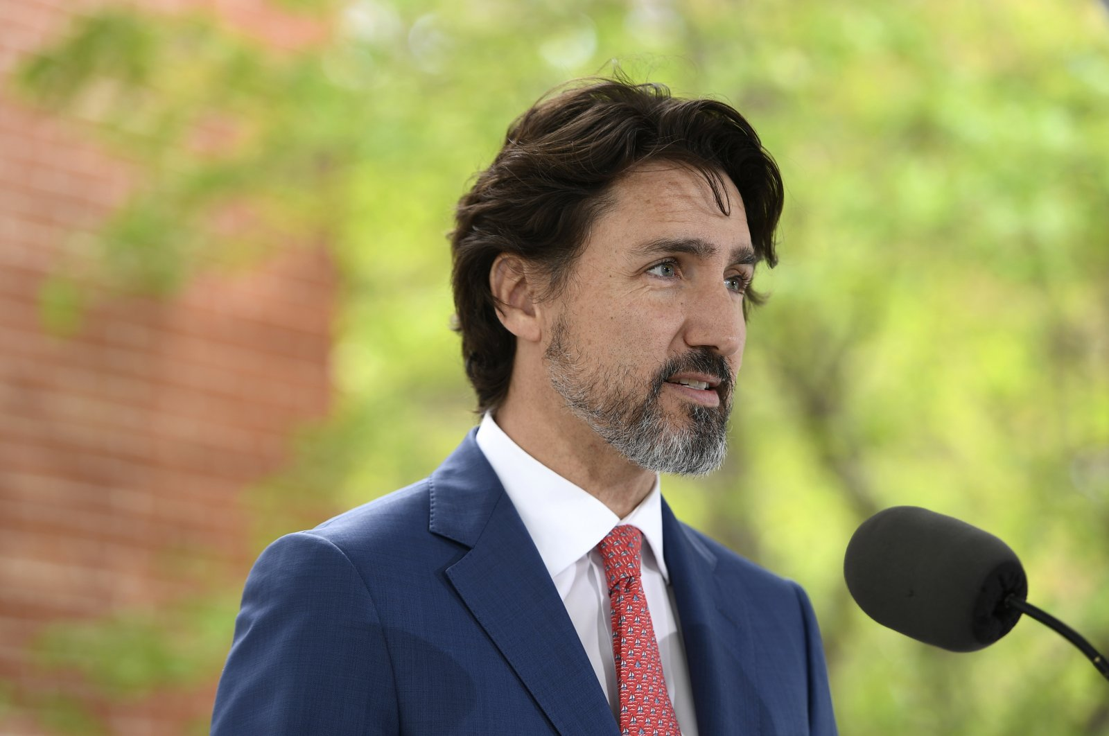 Canadian Prime Minister Justin Trudeau speaks during his daily news conference on the COVID-19 pandemic outside his residence at Rideau Cottage in Ottawa, Ontario, on Tuesday, May 19, 2020. (Justin Tang/The Canadian Press via AP)