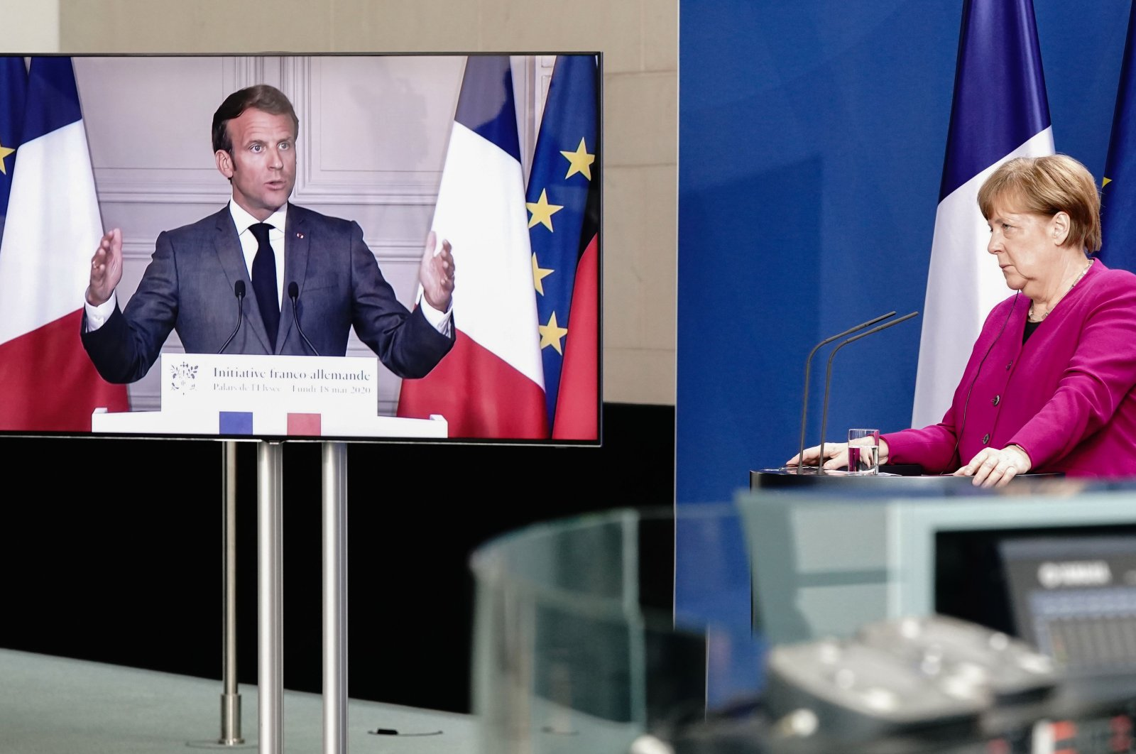 German Chancellor Angela Merkel listens during a joint press conference with French President Emmanuel Macron at the Chancellery, Berlin, May 18, 2020. (AFP Photo)