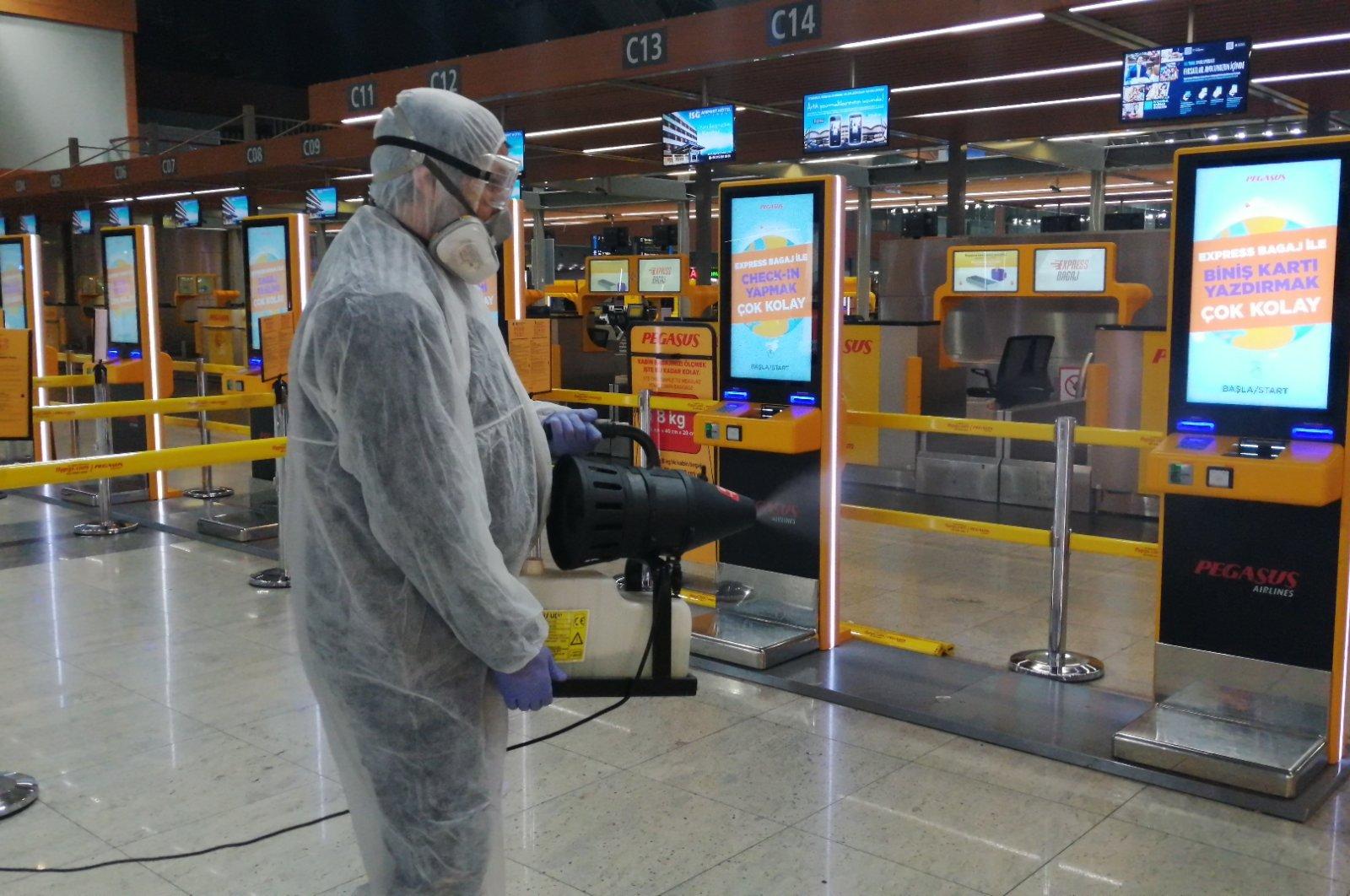A worker sprays disinfectant at Sabiha Gökçen International Airport, Istanbul, Turkey, in this undated photo. (Courtesy of Sabiha Gökçen International Airport)