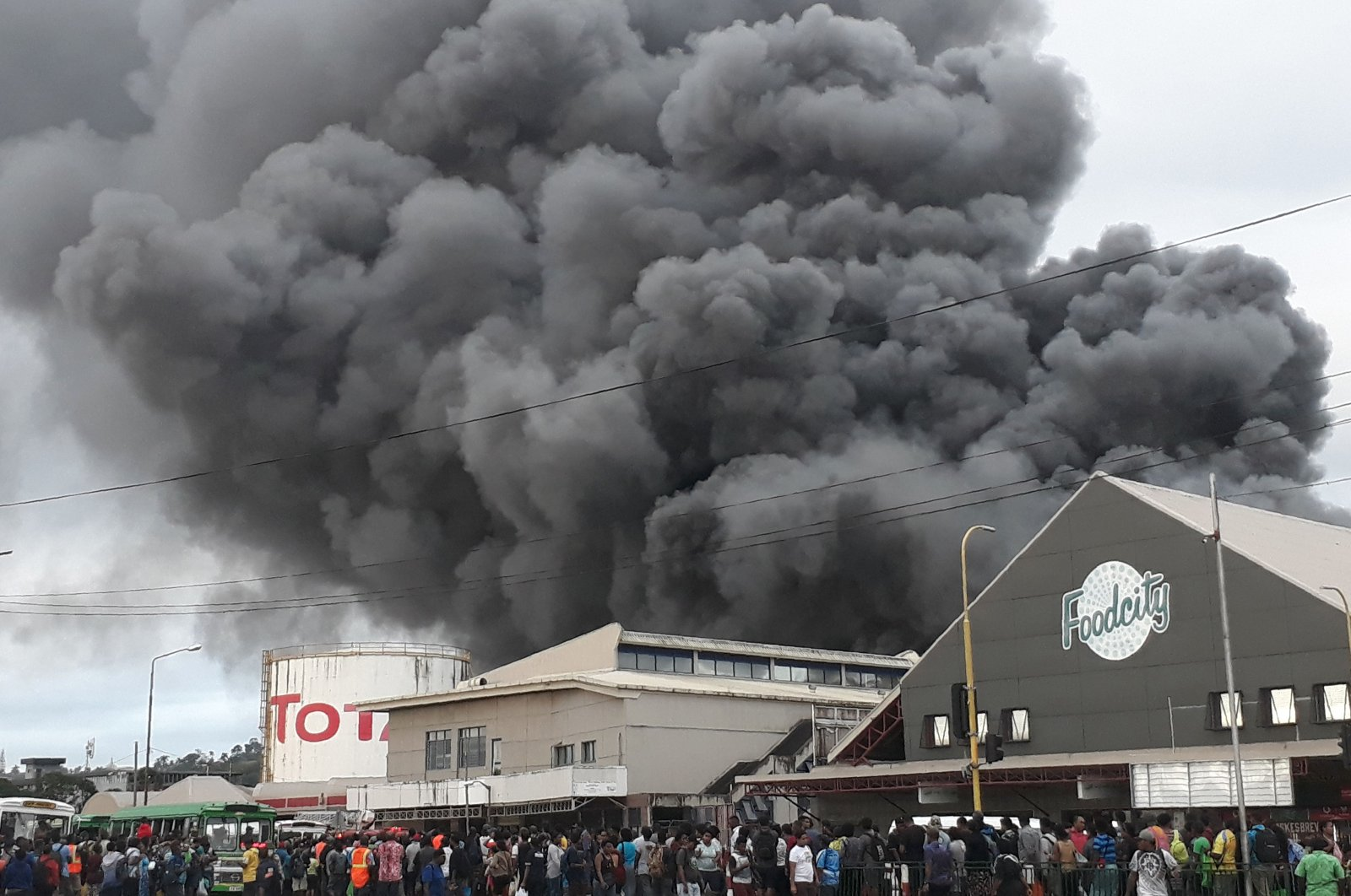 This handout photo released to AFP courtesy of Ropate Valemei and taken on May 22, 2020 shows thick smoke rising from a huge fire at one of Suva's largest markets in the Fijian capital before it was brought under control. (Courtesy of Ropate Valemei via AFP Photo)