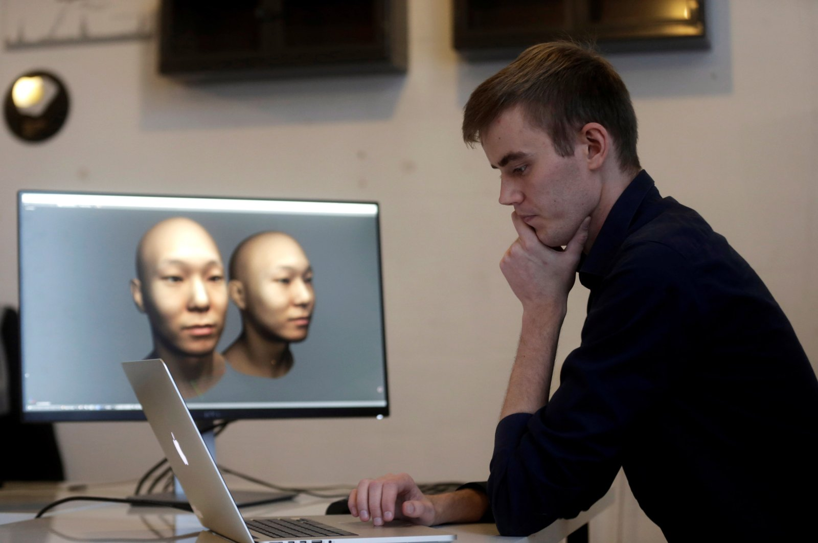 Rainer Selvet inspects 3D virtual reality renderings in Tallinn, Estonia, Nov. 8, 2016. (Reuters Photo)