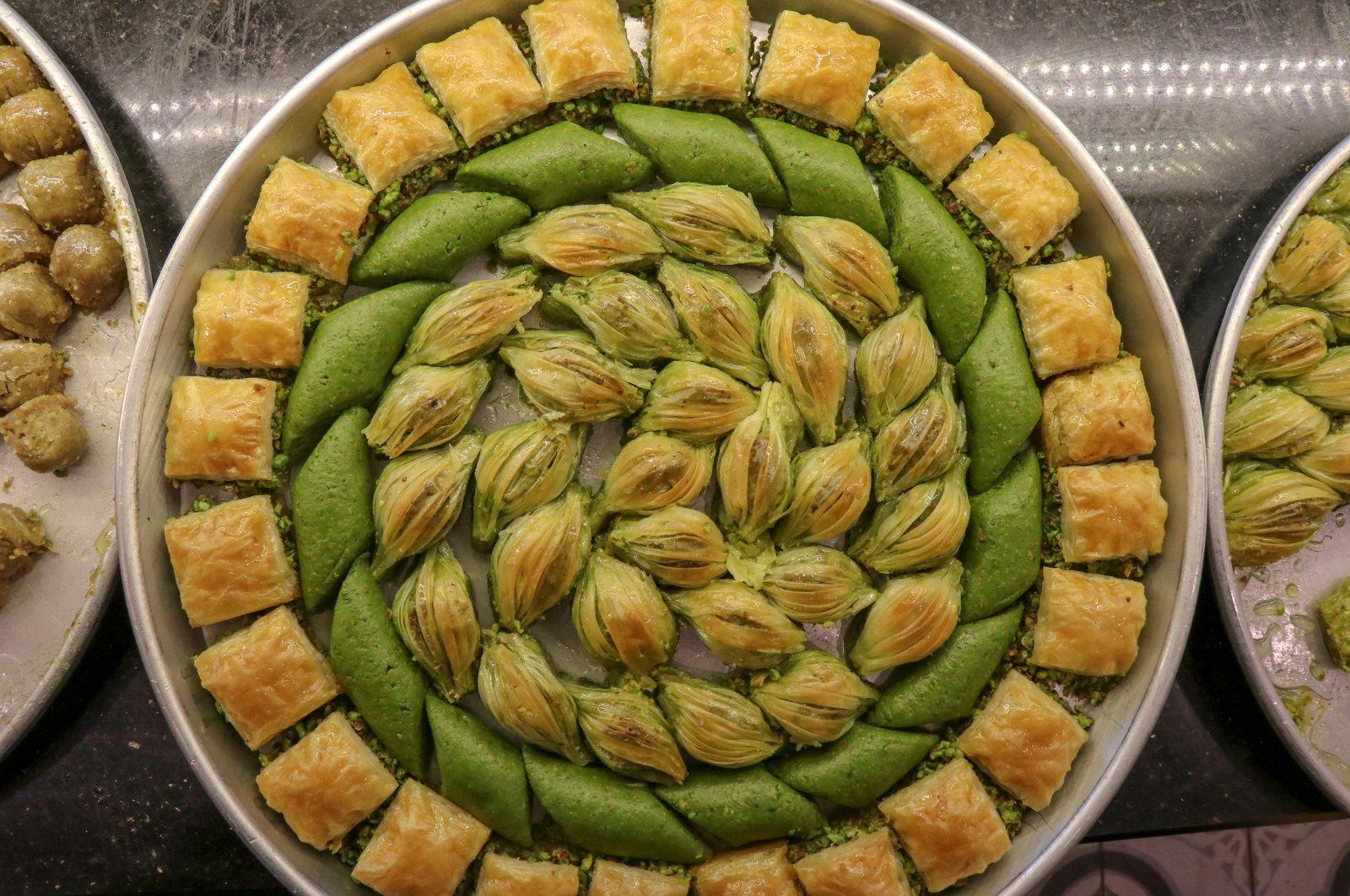 This photo shows mixture of Turkish desserts including Baklava, Pistachio Wrap and Saray Sarması, May 22, 2020. (AA Photo)