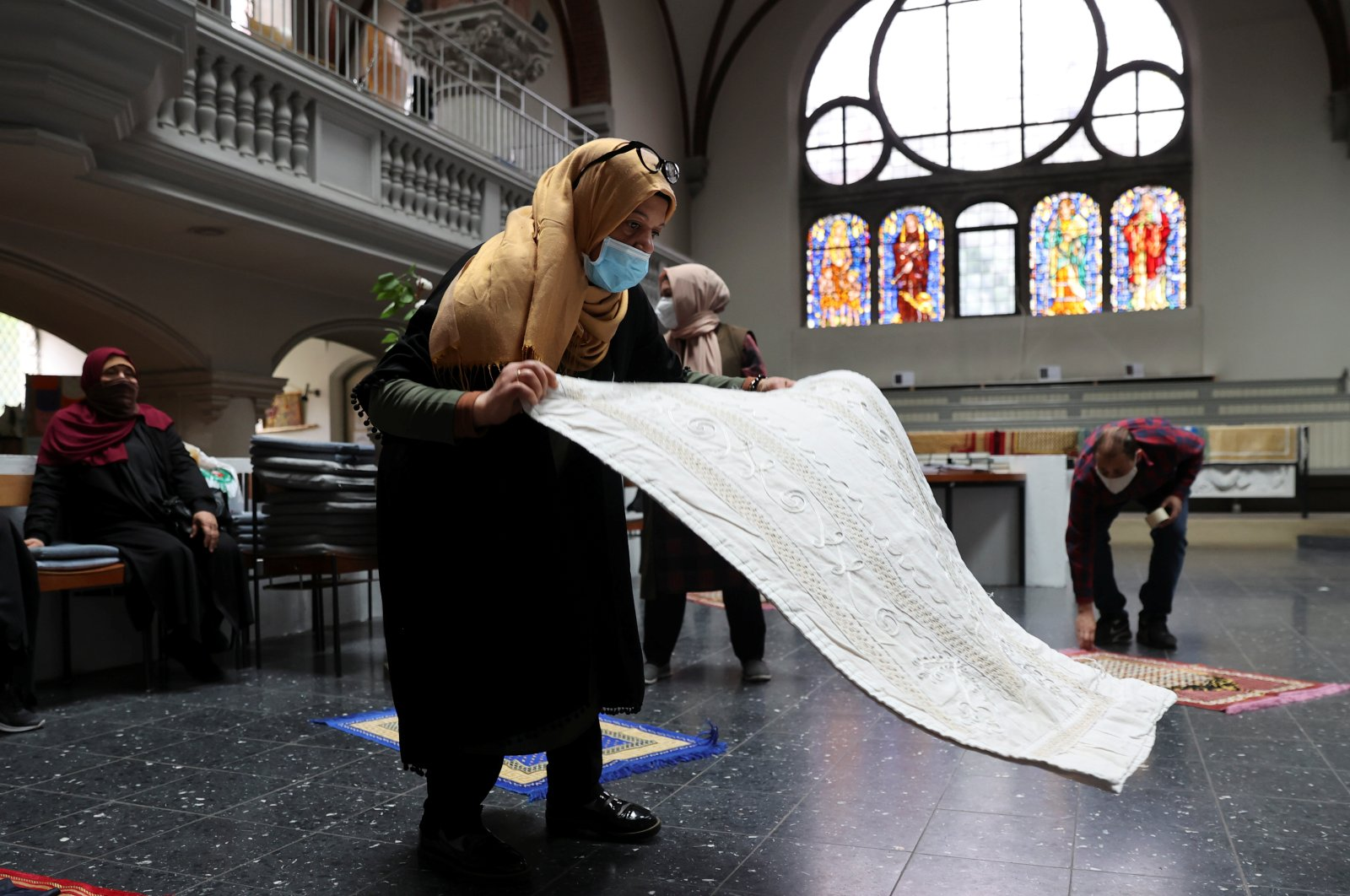 A muslim prepares inside the evangelical church of St. Martha's parish, for their Friday prayers, as the community mosque can't fit everybody in due to social distancing rules, amid the coronavirus disease (COVID-19) outbreak in Berlin, Germany, May 22, 2020. (Reuters Photo)