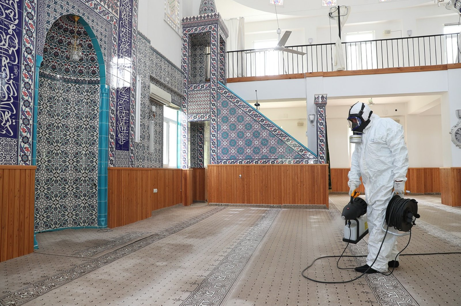 A worker disinfects a mosque in Denizli, Turkey, May 21, 2020. (İHA Photo)