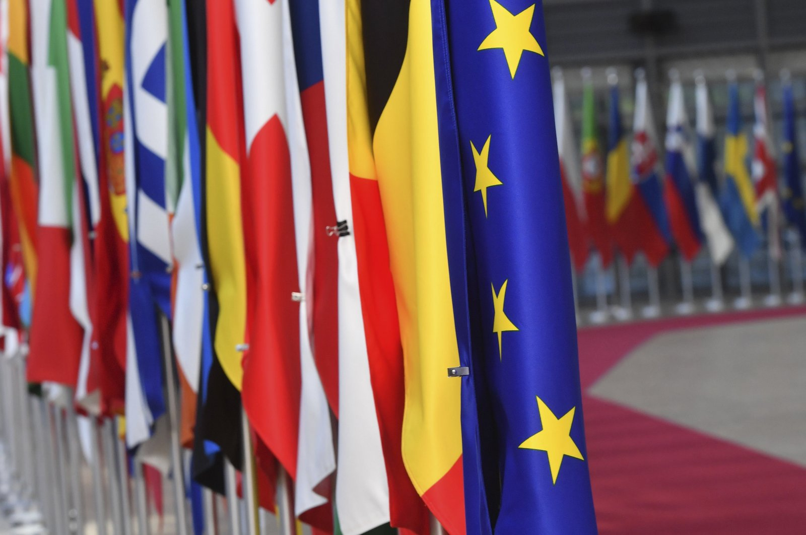The European Union flag is displayed with EU member countries' flags at the European Council in Brussels, May 13, 2019. (AFP Photo)