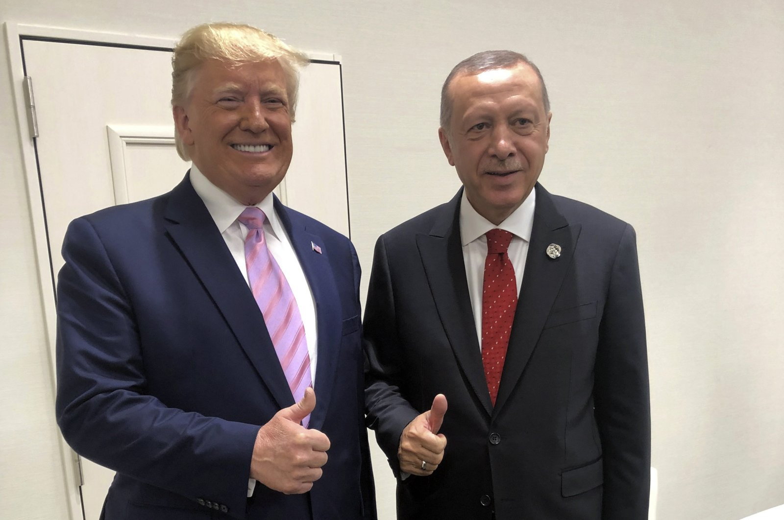 President Recep Tayyip Erdoğan, and U.S President Donald Trump gesture during the G-20 summit in Osaka, Japan, Friday, June 28, 2019. (AP Photo)