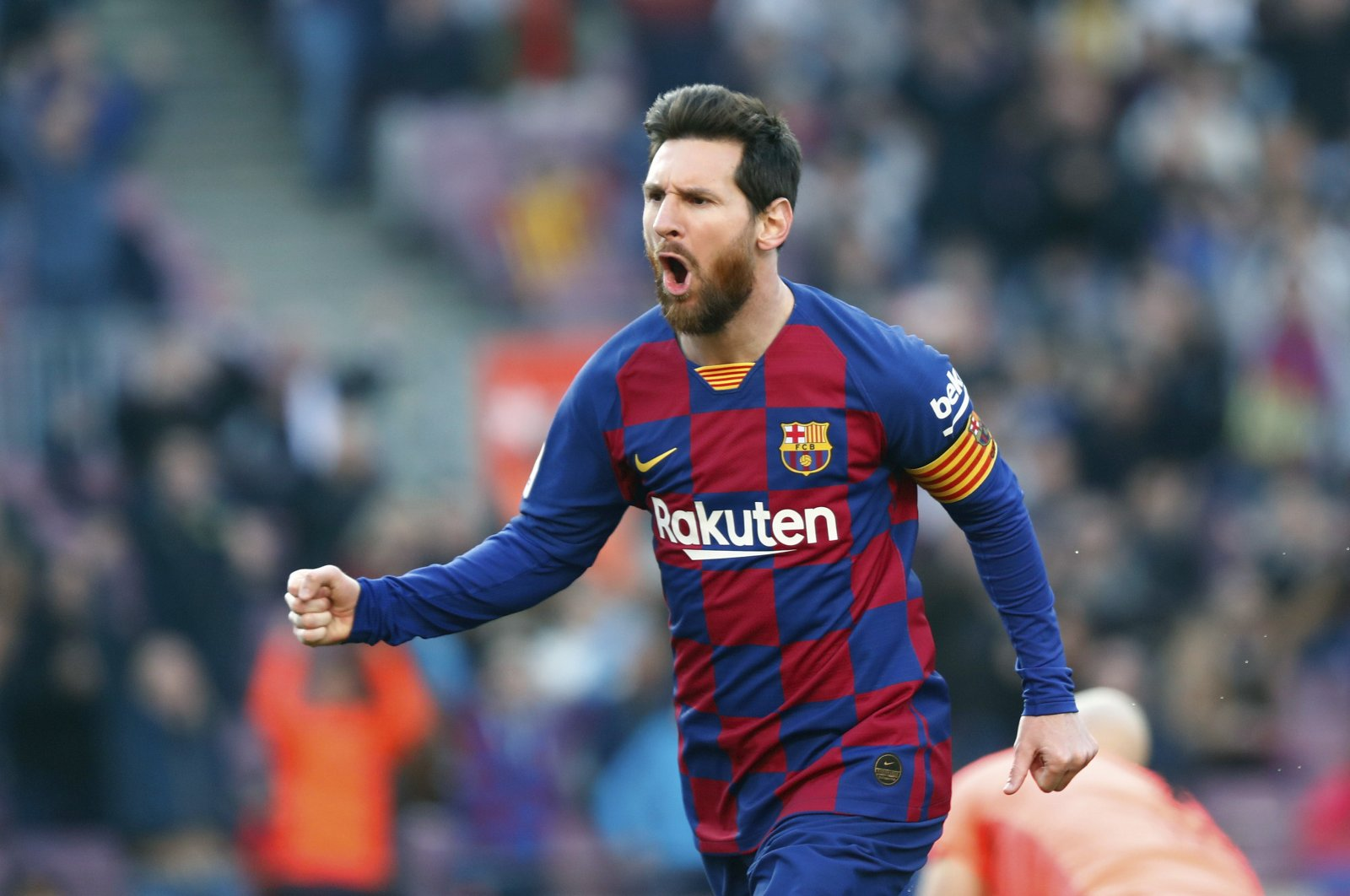 In this Saturday, Feb. 22, 2020 file photo, Barcelona's Lionel Messi celebrates after scoring his side's opening goal during a Spanish La Liga soccer match between Barcelona and Eibar at the Camp Nou stadium in Barcelona, Spain. Spanish Prime Minister Pedro Sánchez announced Saturday, May 23, 2020 that the soccer league in Spain will be allowed to resume from June 8. (AP Photo/Joan Monfort, File)