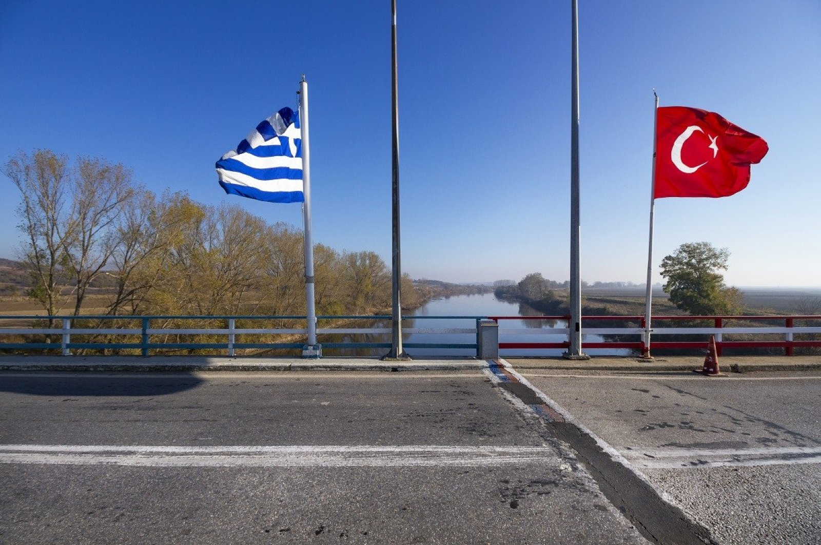 The flags of Turkey and Greece as seen at a border gate.