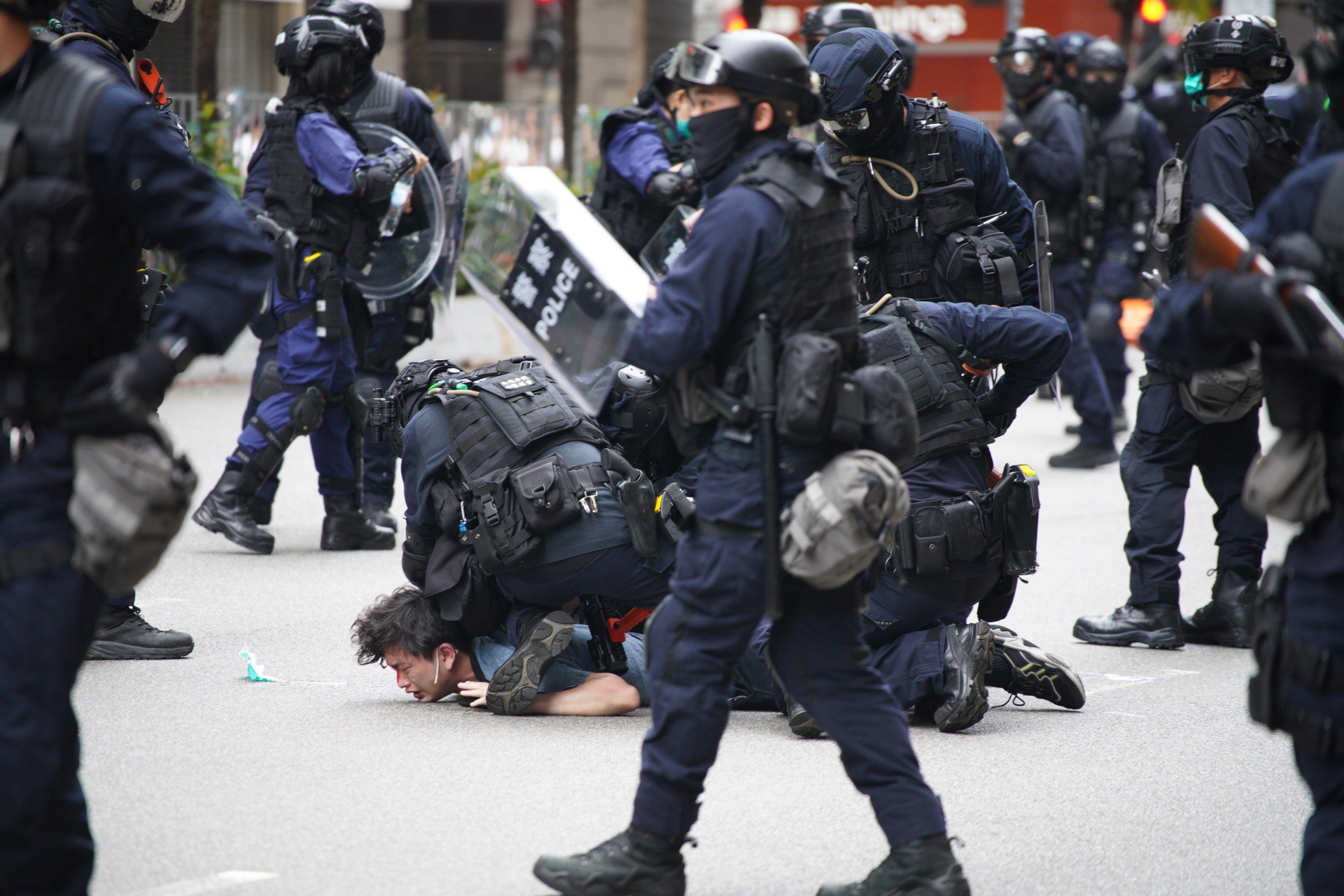 Police special tactical squad detain a protester (C) in Wanchai, Hong Kong on May 24, 2020, as thousands of demonstrators took to the streets to protest against a national security law. (AFP Photo)