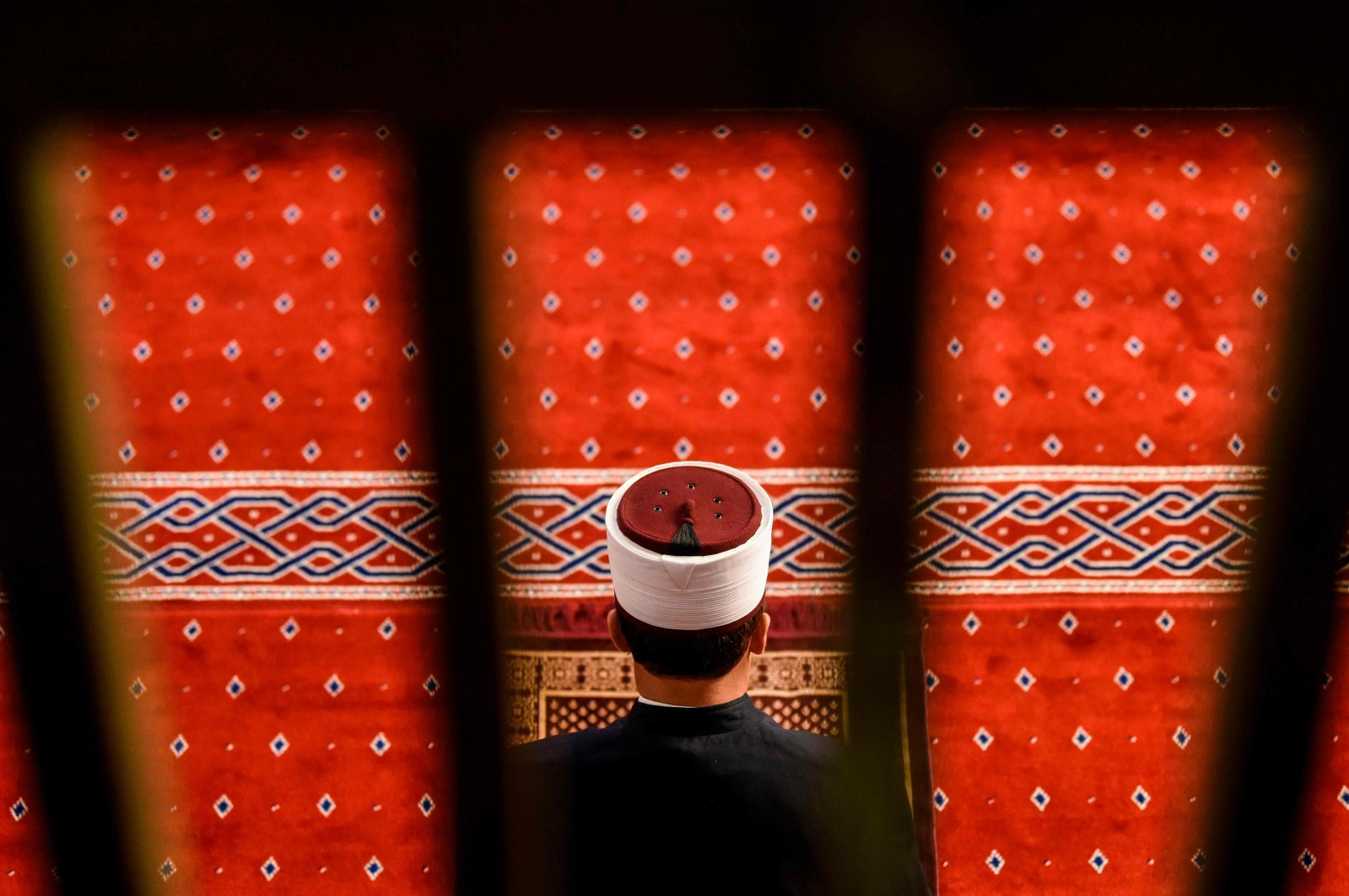An imam attends Eid al-Fitr prayers, at the Grand Mosque, Pristina, Kosova, May 24, 2020. (AFP Photo)