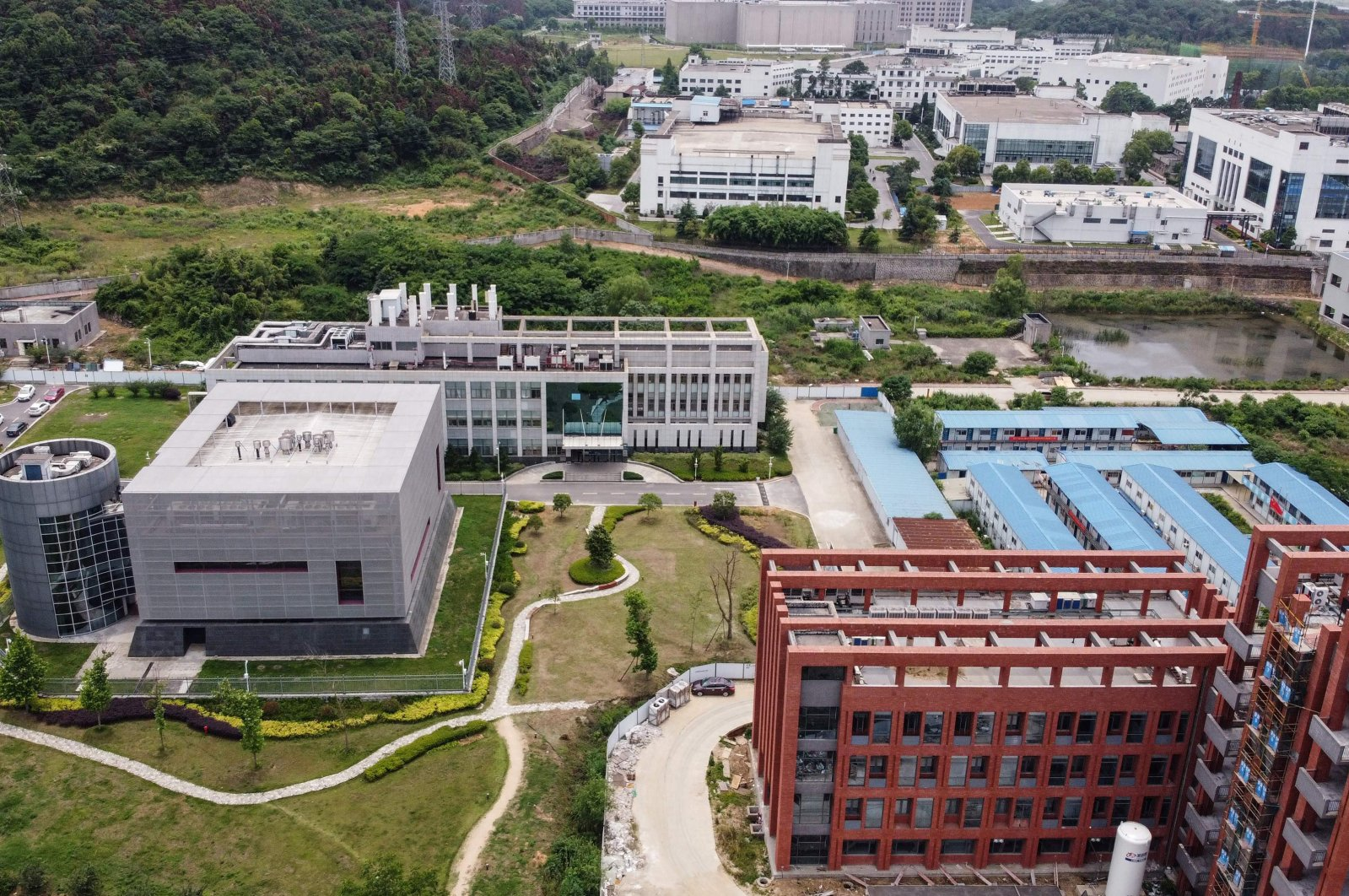 This aerial view shows the P4 laboratory (L) on the campus of the Wuhan Institute of Virology, Wuhan, central Hubei province, China, May 13, 2020. (AFP Photo)