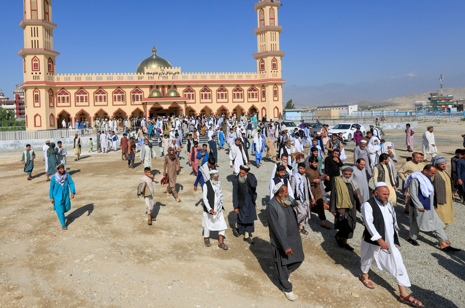 Afghan men leave a mosque after prayers during Eid al-Fitr, a Muslim festival marking the end of the holy fasting month of Ramadan, amid the spread of the coronavirus disease (COVID-19), in Laghman province, Afghanistani May 24, 2020. (REUTERS Photo)