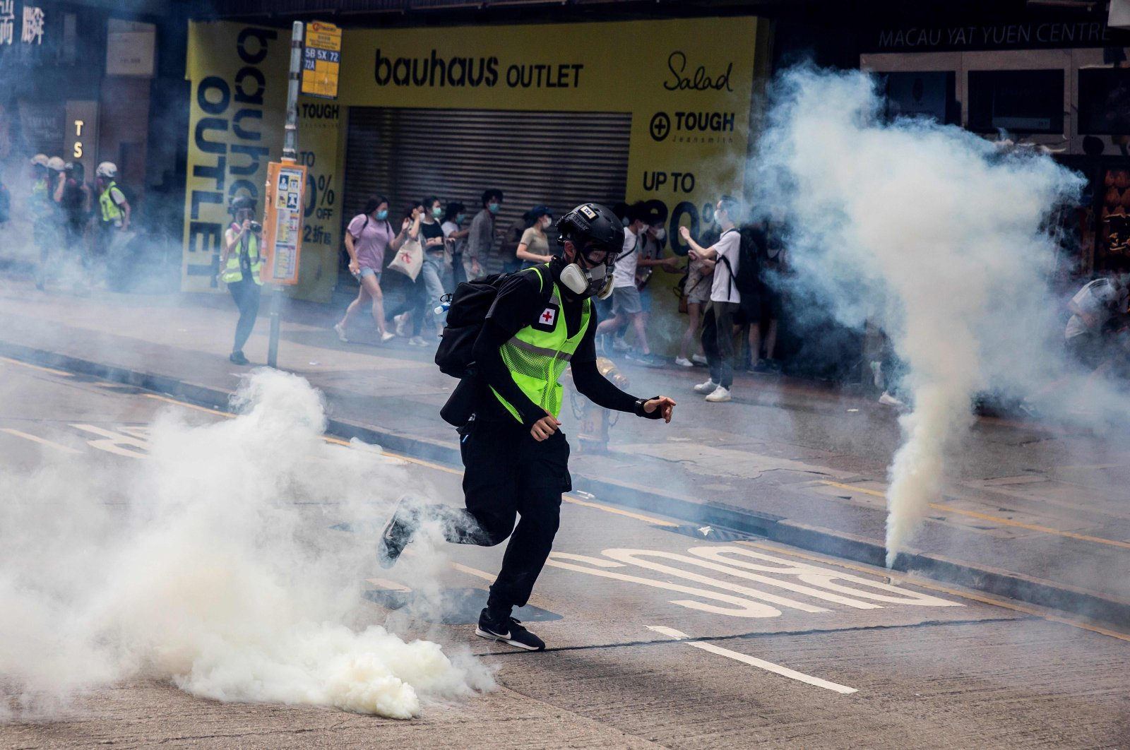 Police fire tear gas on protesters during planned protests against a proposal to enact a new security legislation in Hong Kong on May 24, 2020. (AFP Photo)