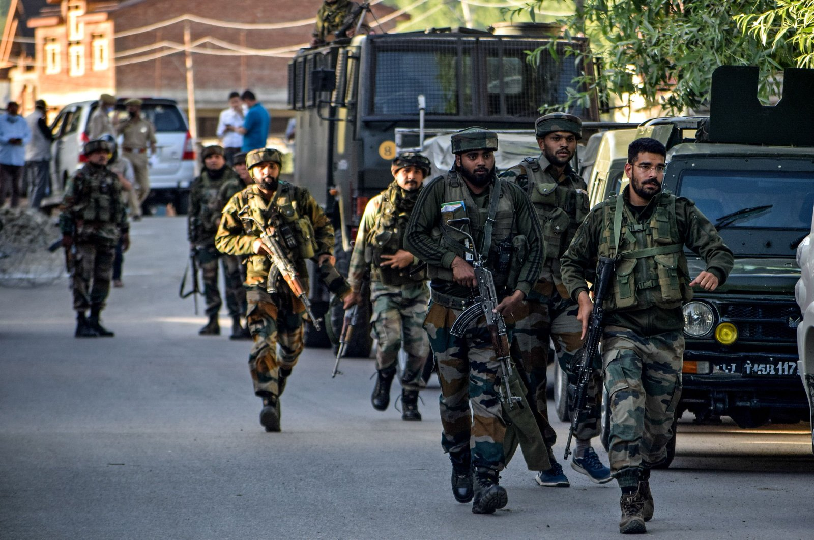 Security personnel arrive near the scene of a recent militant attack at Pandach Chowk area of central Kashmir's Ganderbal district on the outskirts of Srinagar on May 20, 2020. (AFP Photo)