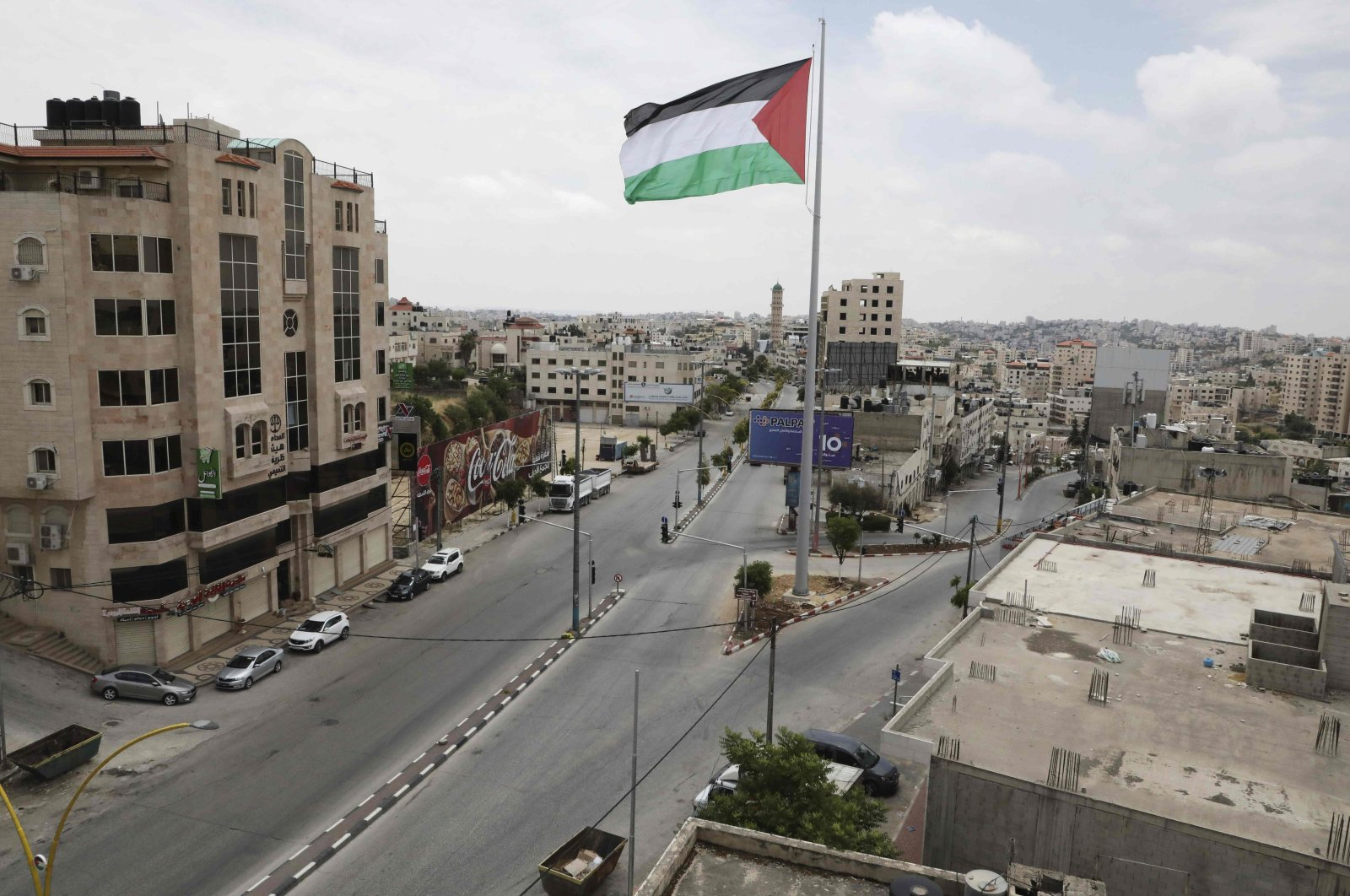 A view shows a deserted street in the occupied West Bank city of Hebron on the last day of the Muslim fasting month of Ramadan amid the COVID-19 pandemic, on May 23, 2020. (AFP Photo)