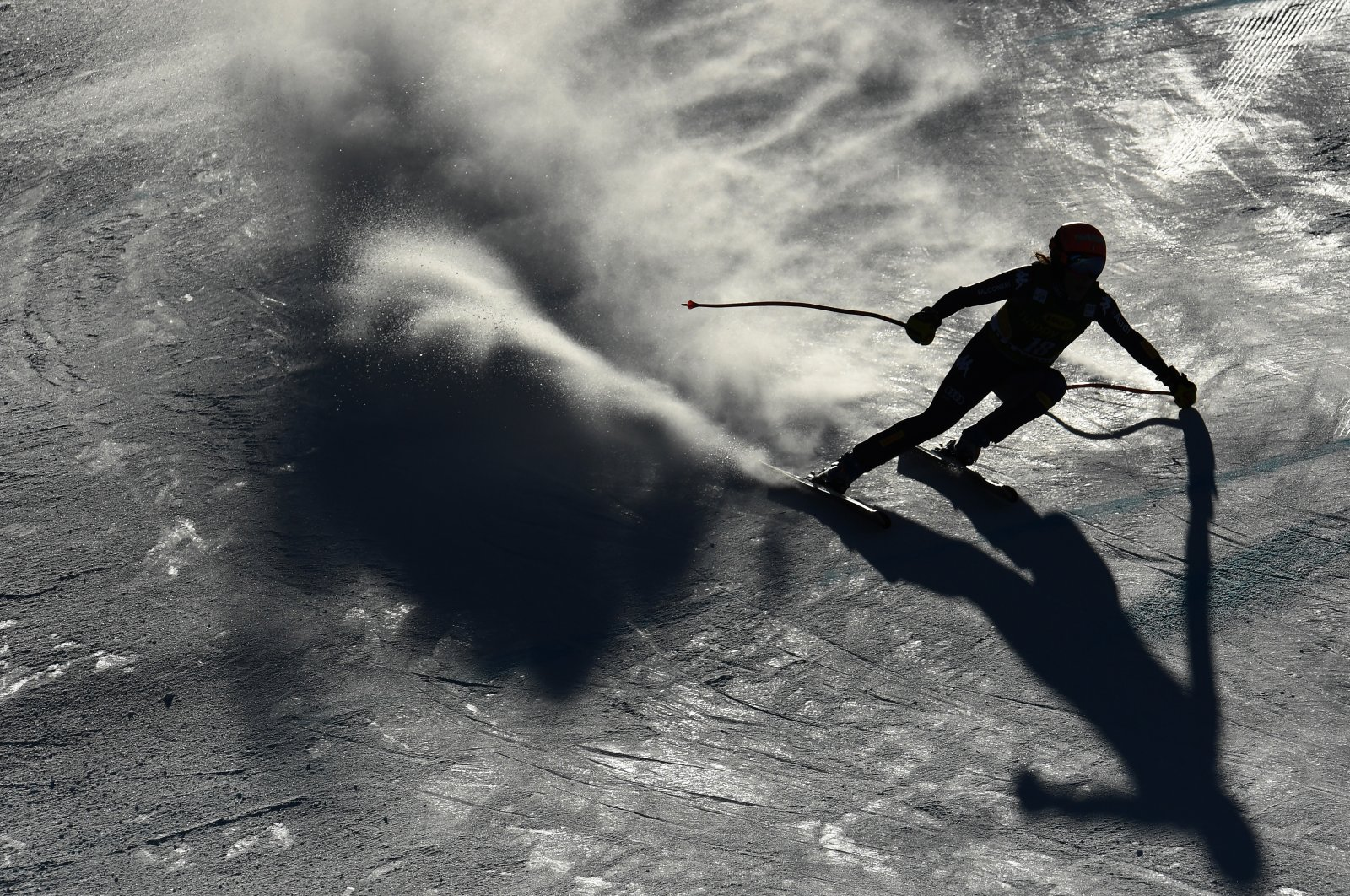 The backlight makes the snow slope appear grey as Federica Brignone of Italy races downhill during the FIS Alpine Ski World Cup in Bansko, Bulgaria, January 24, 2020. (reissued 21 May 2020).  (EPA Photo)